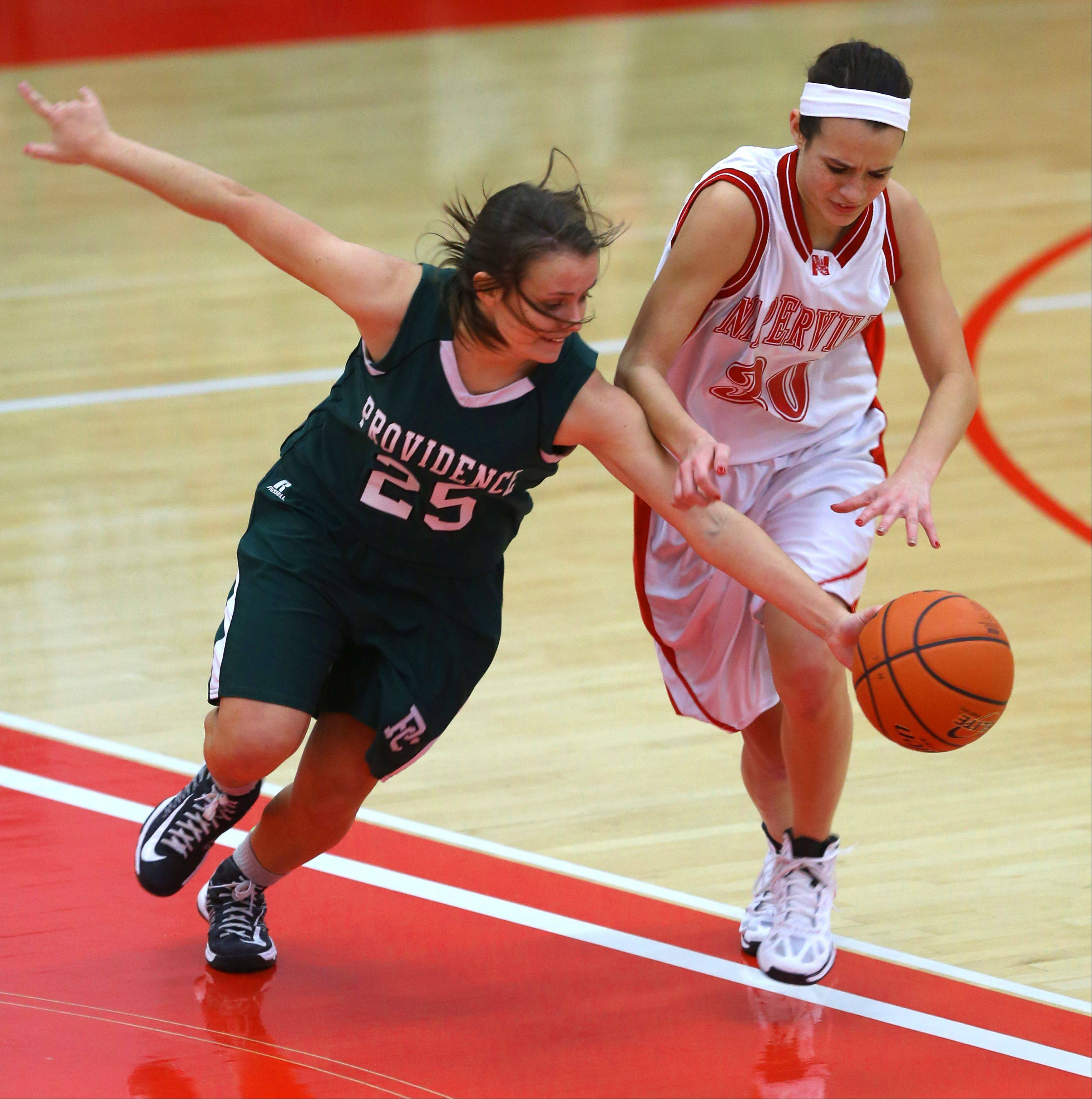 Naperville Central's Shannon Ryan, right, battles Providence's Anne Corso (25), during the 2013 girls basketball Tip-Off Tournament.
