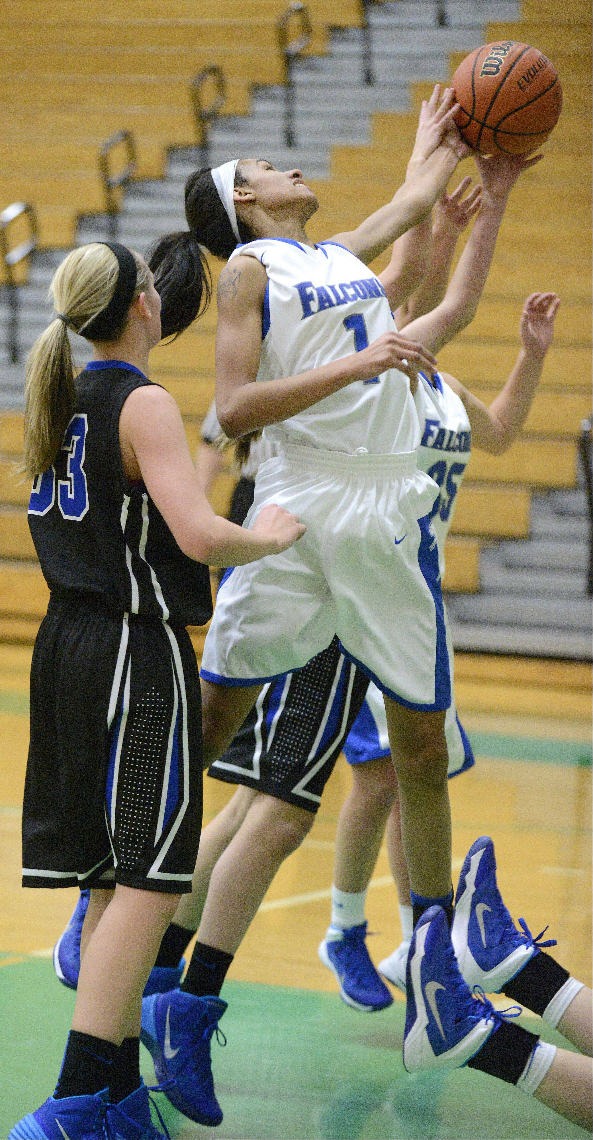 Wheaton North's Emari Jones fights for a rebound in the first quarter on Friday, November 22.
