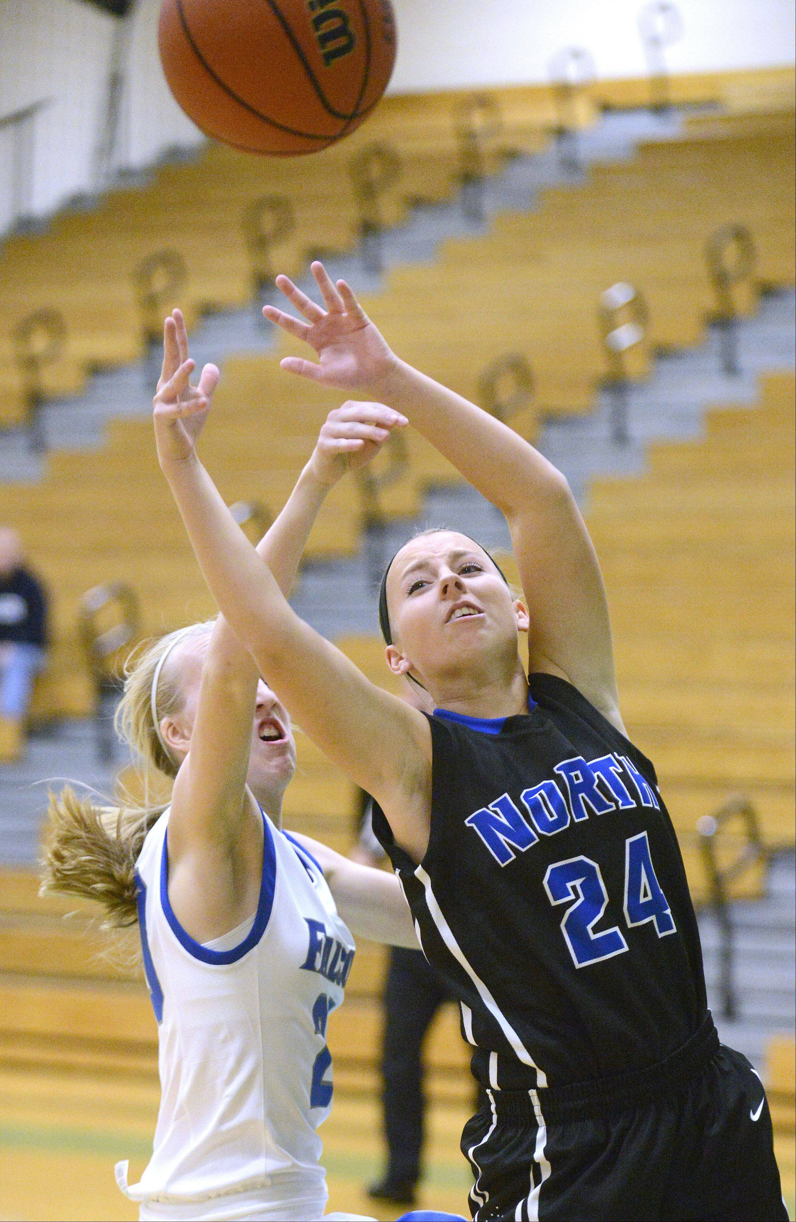Wheaton North's Abby Tiesman knocks the ball out of the hands of St. Charles North's Allie Reed as she goes up for the hoop in the first quarter on Friday, November 22.