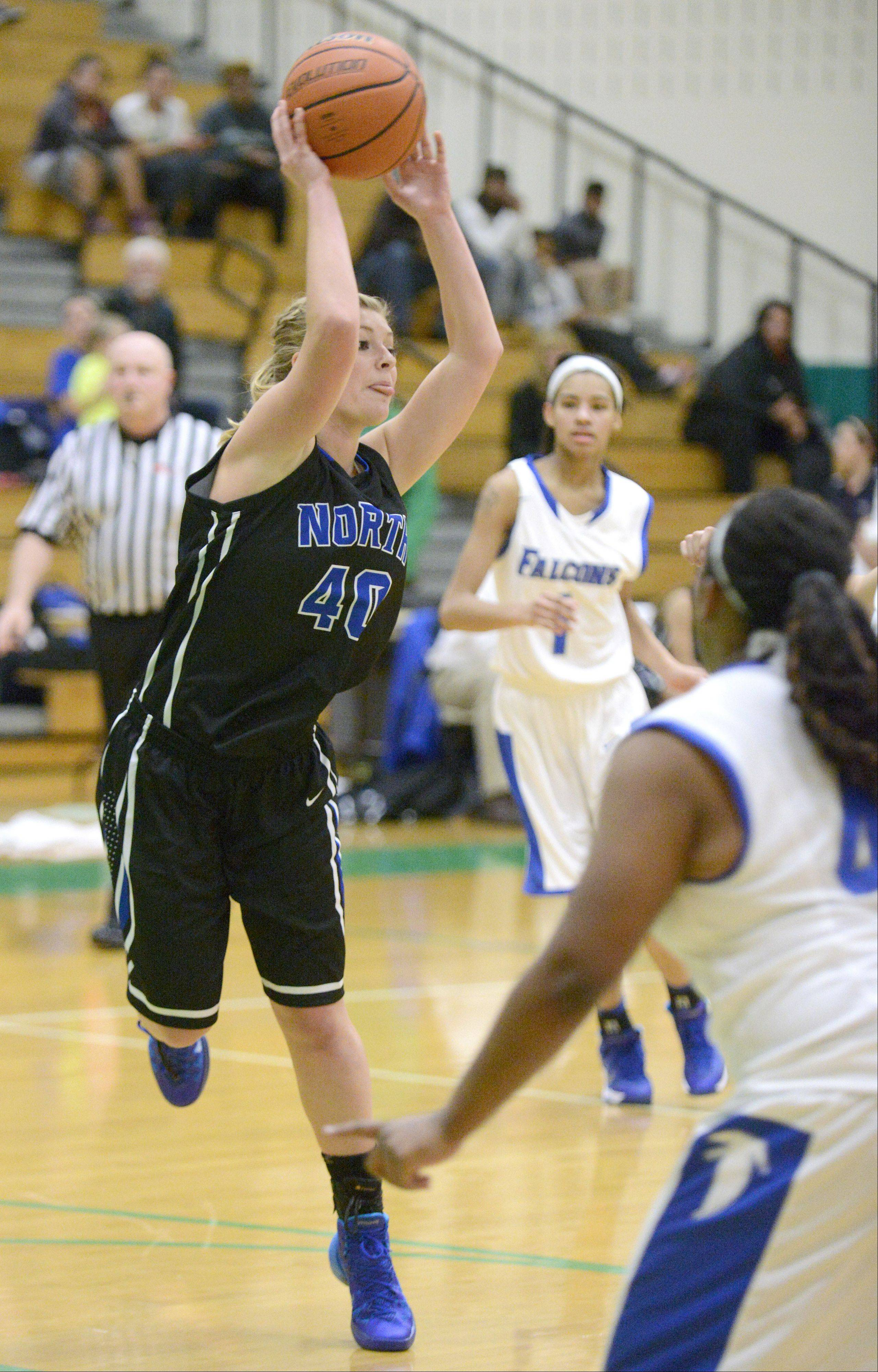 St. Charles North's Abby Mackay-Zacker whips the ball to a teammate in the second quarter on Friday, November 22.