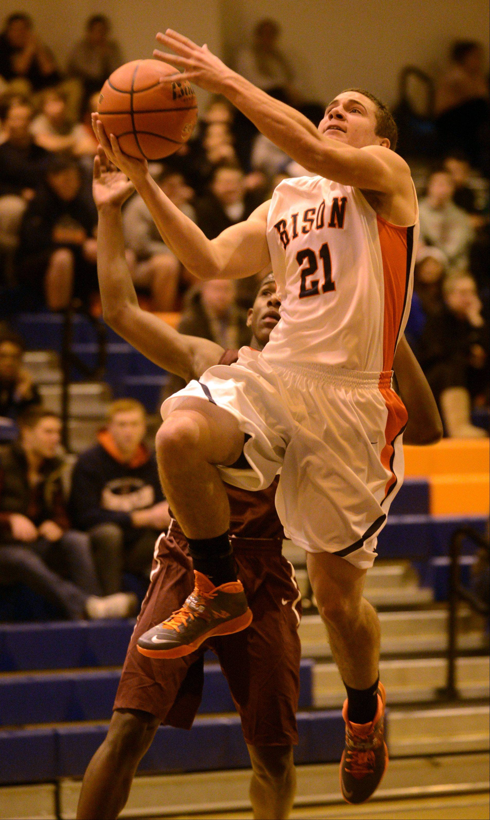 Buffalo Grove's Scott Smithern takes the ball to the hoop against Elgin at Buffalo Grove on Monday evening.