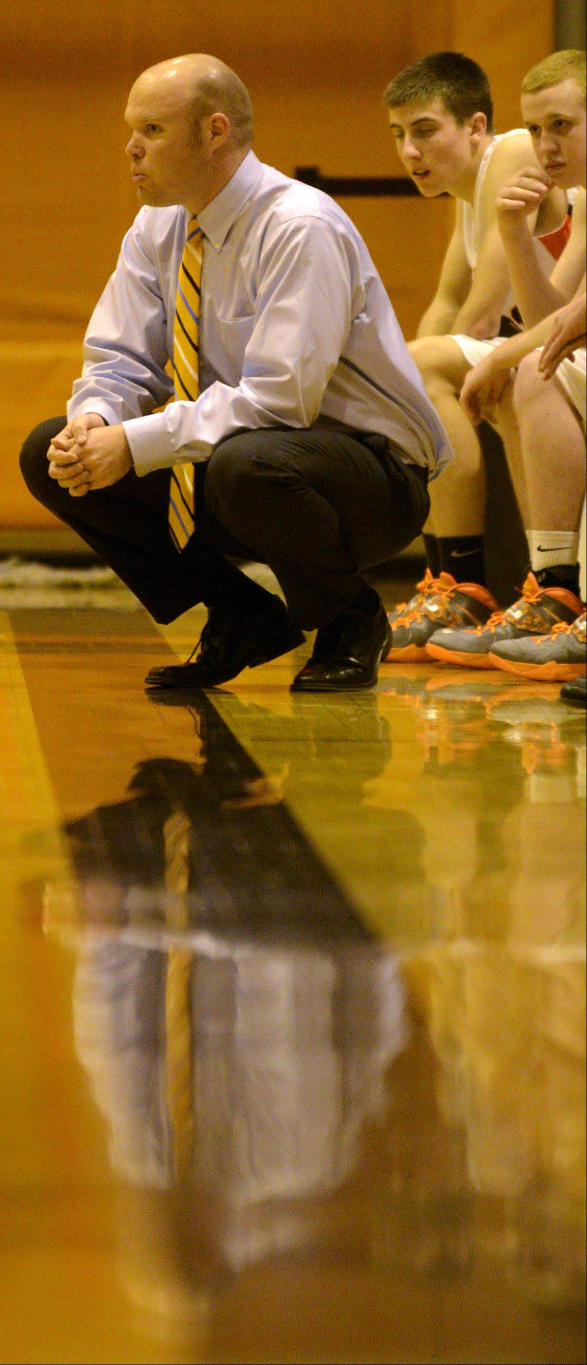 First-year Buffalo Grove coach Keith Peterson keeps his eye on the action against Elgin at Buffalo Grove on Monday evening.