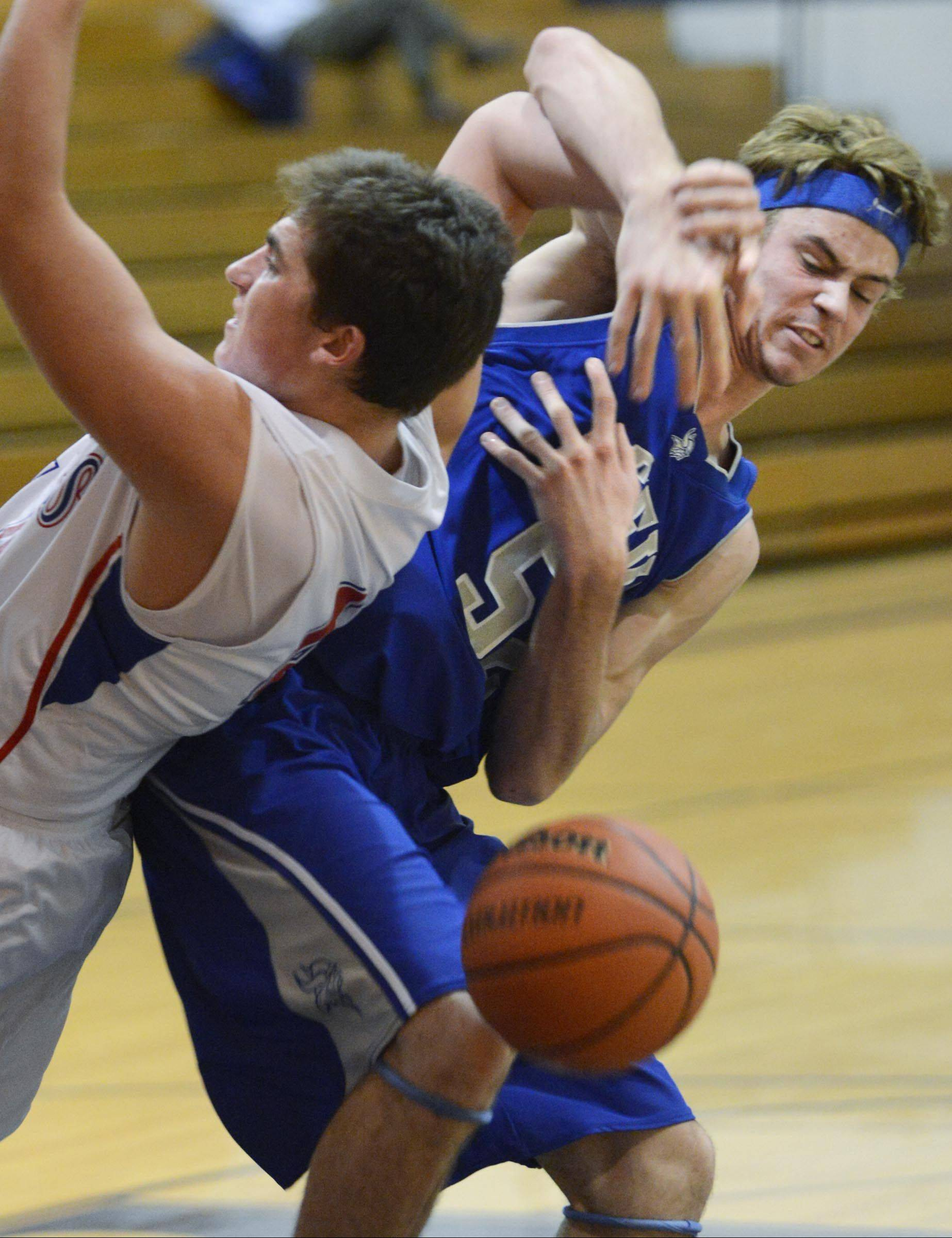 Geneva's Mike Landi and Marmion's Danny Bicknell get tangled under the basket Monday.