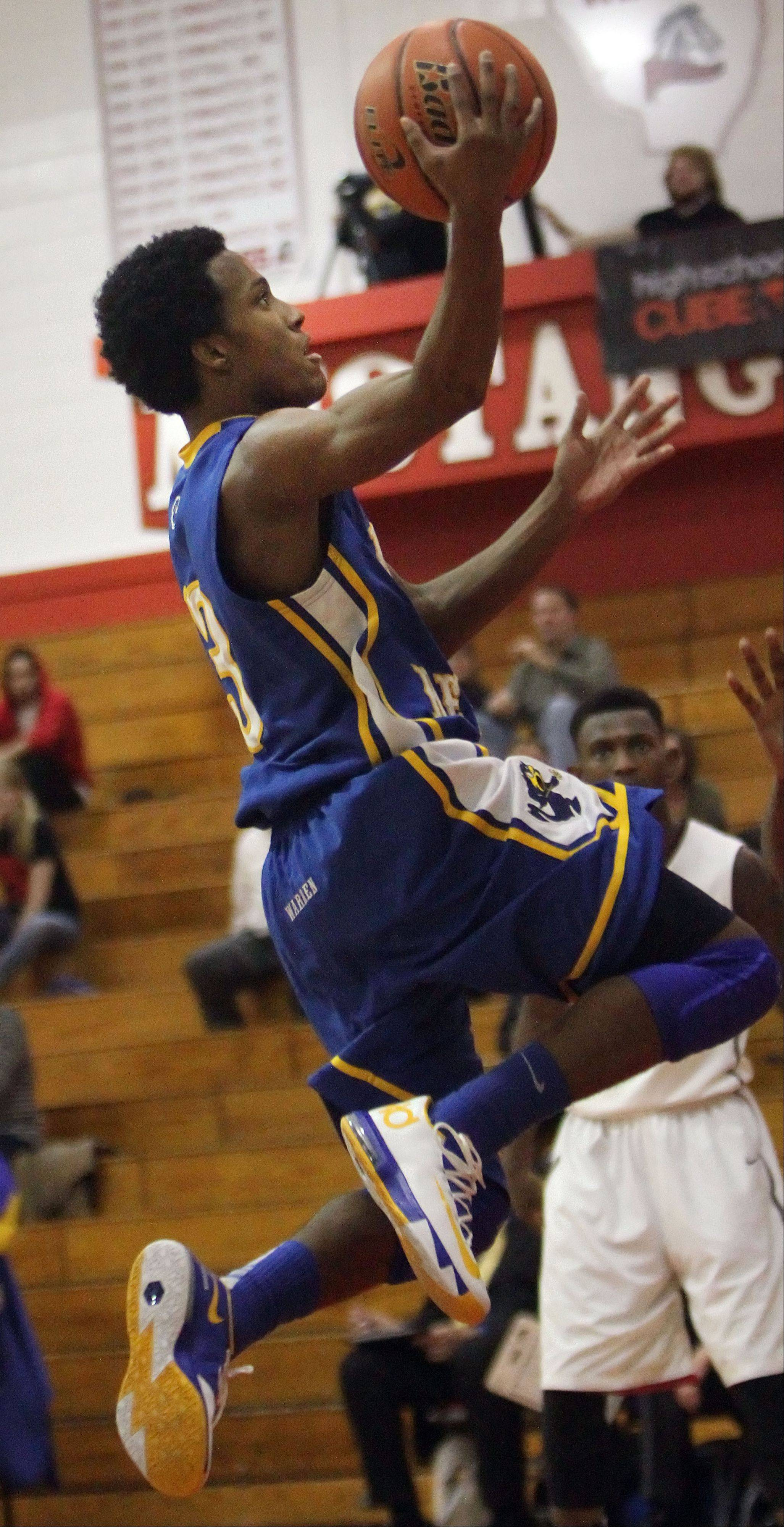 Warren's Eric Gillespie drives to the hoop during the Blue Devils' loss to Uplift on Tuesday at Mundelein.