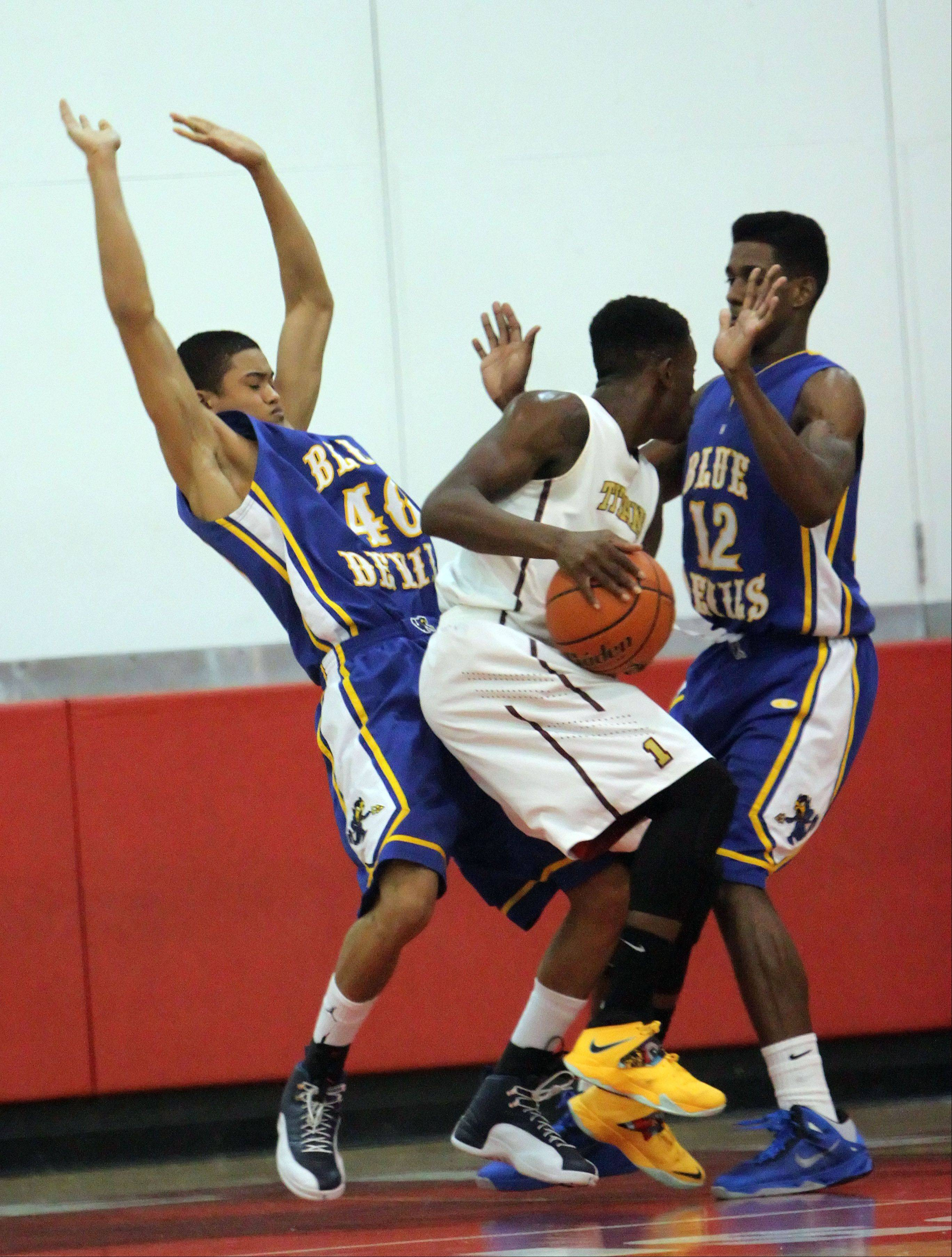 Steve Lundy/slundy@dailyherald.comWarren's CJ Payawal, left, and Greg Swain double team Uplift's Augustin Tronou on Tuesday at Mundelein.