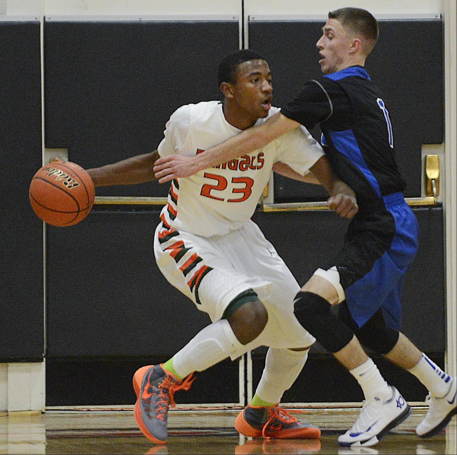 St. Charles North's Alec Goetz guards Plainfield East's Aaron Jordan Tuesday in St. Charles.