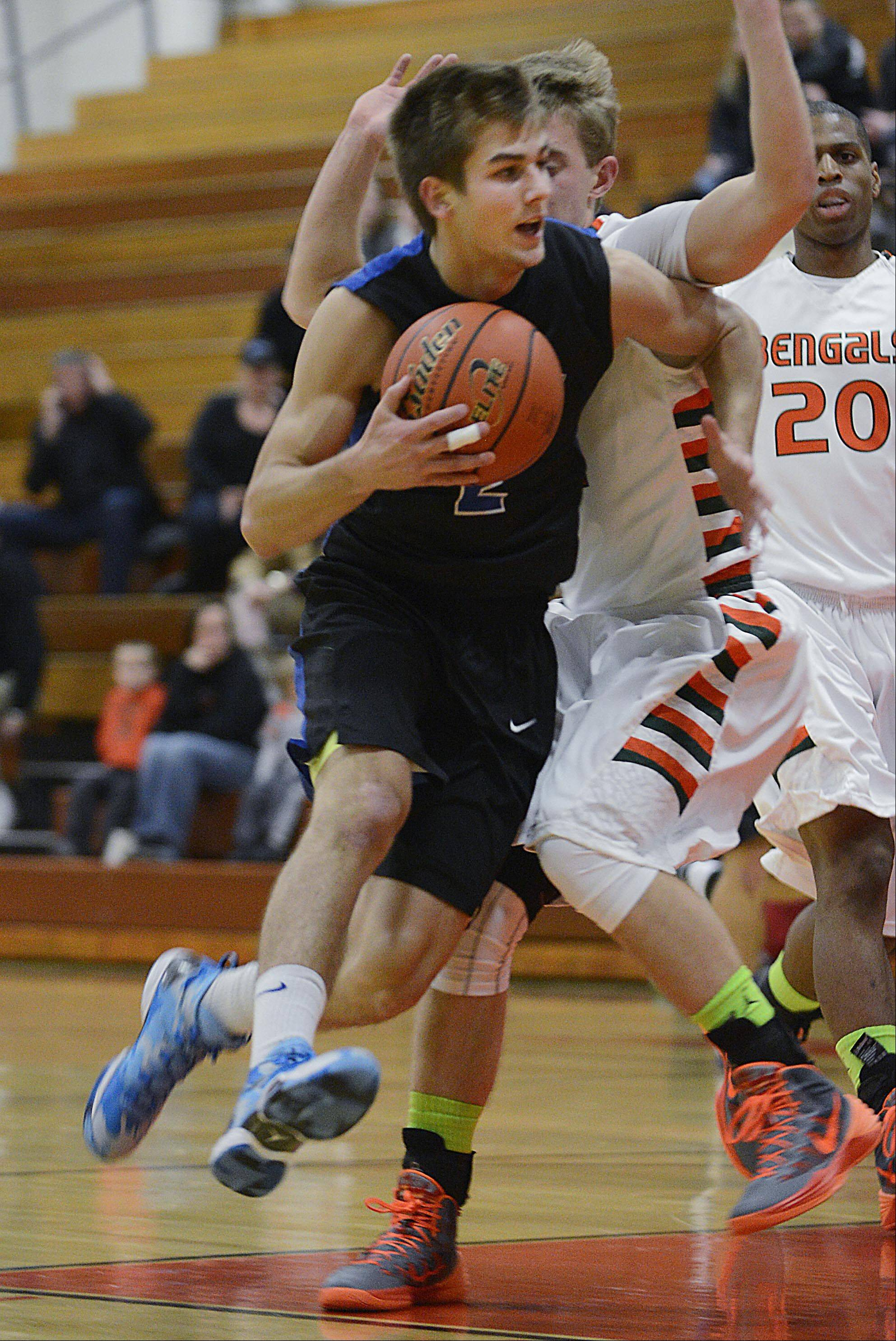 St. Charles North's Jake Ludwig drives around Plainfield East's Nick Novak Tuesday in St. Charles.