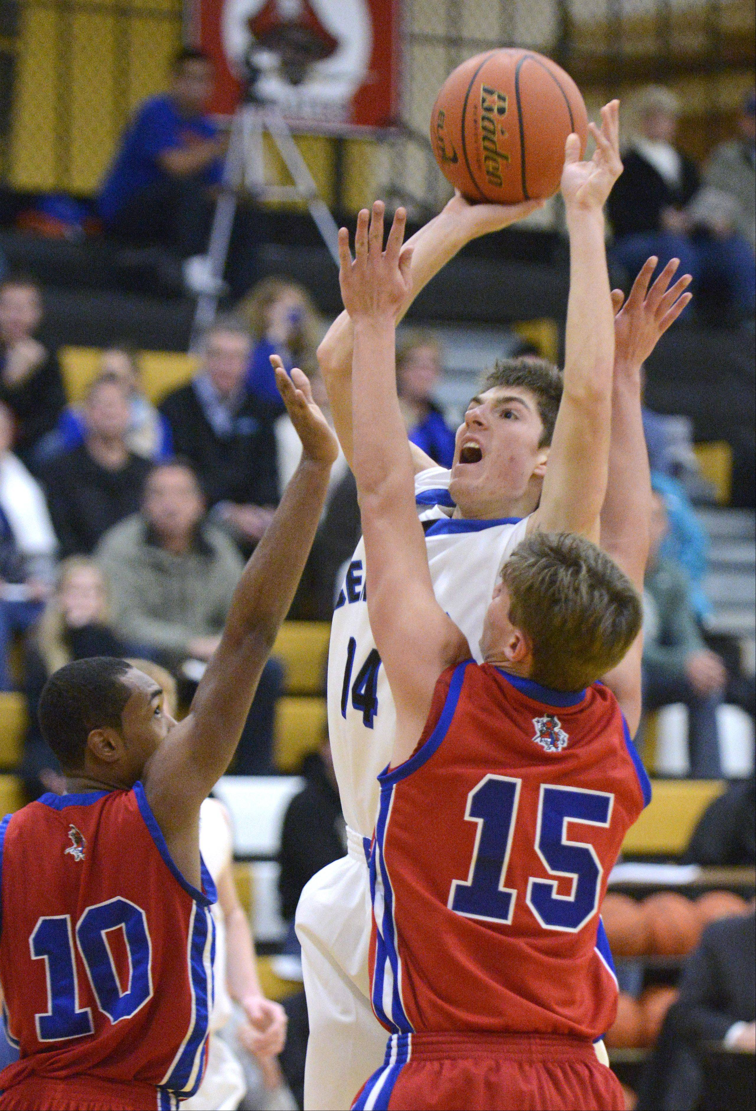 Burlington Central's Jacob Schutta sinks a shot over a block by Dundee-Crown's Kiwaun Seals (10) and Nick Munson in the third quarter on Tuesday at Sycamore.