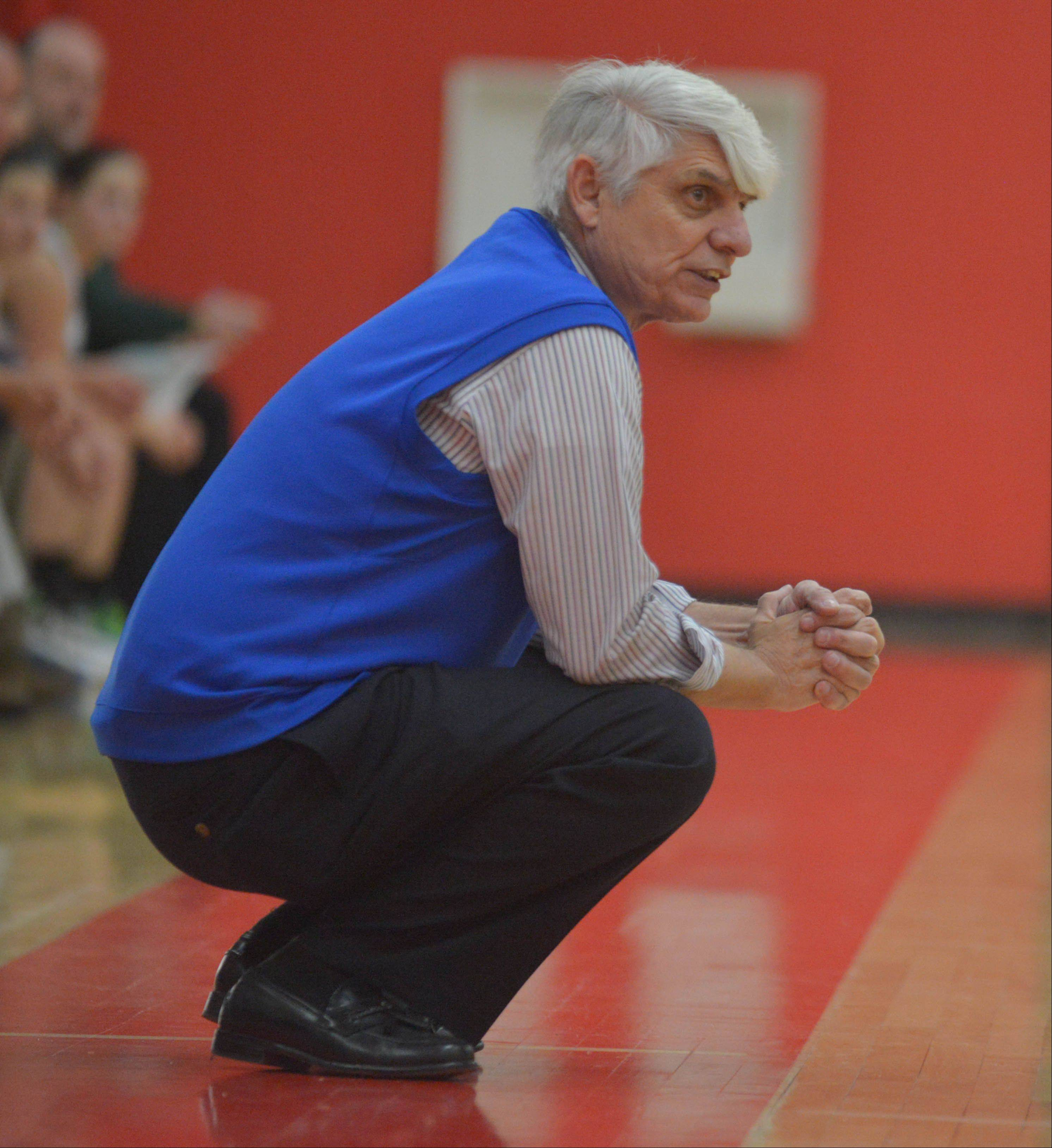 Paul Michna/pmichna@dailyherald.comBenet Girls Coach Peter Paul works the floor.