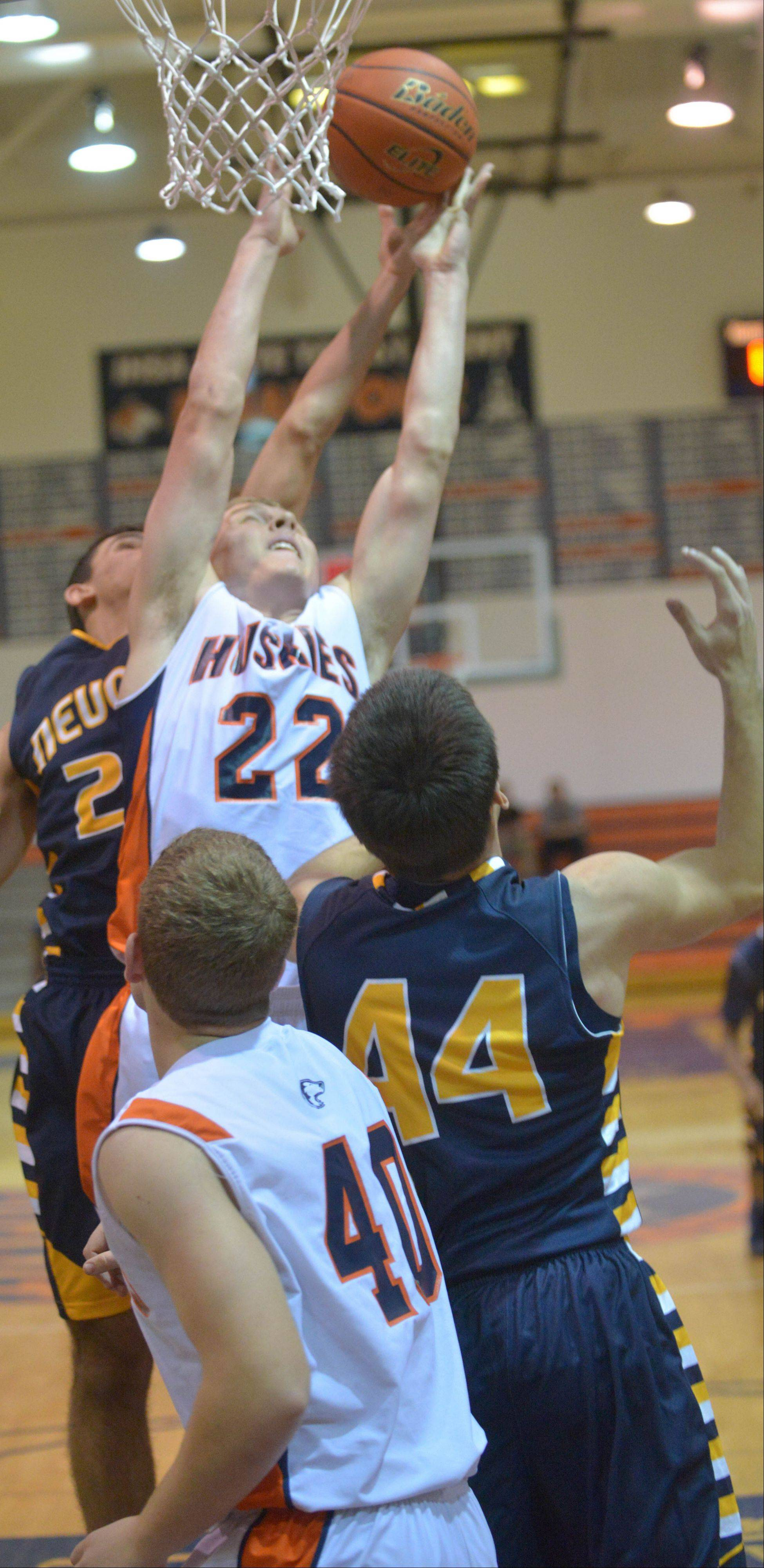 Baylor Griffin of Naperville North goes for a rebound during the Neuqua Valley at Naperville North boys basketball game Wednesday.