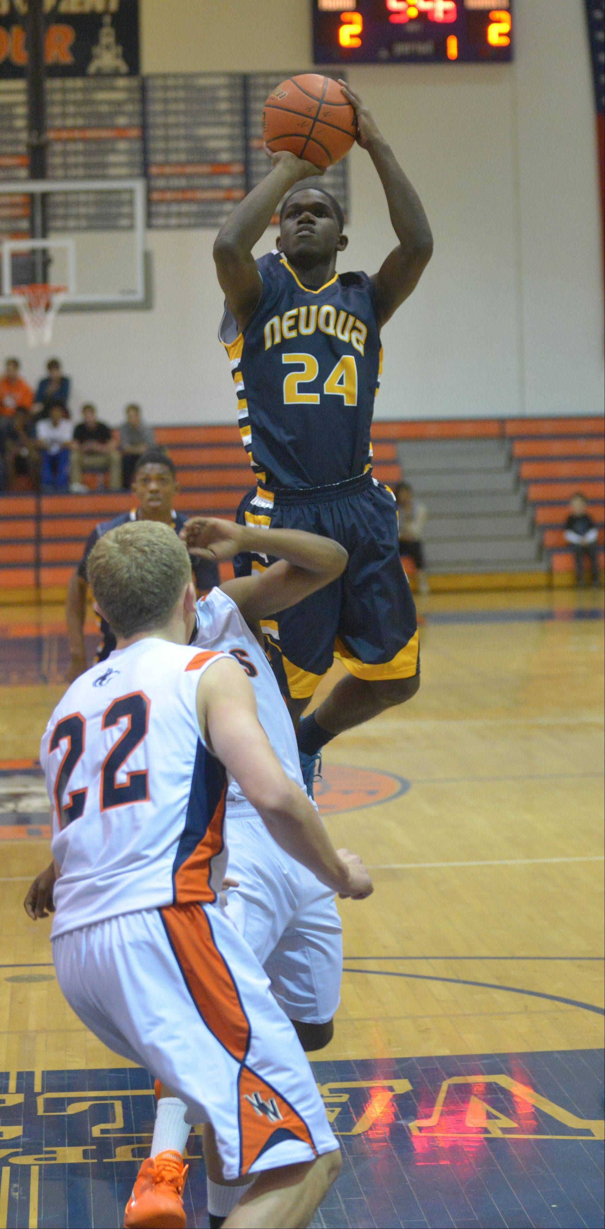 Demond George of Neuqua Valley takes a shot during the Neuqua Valley at Naperville North boys basketball game Tuesday.