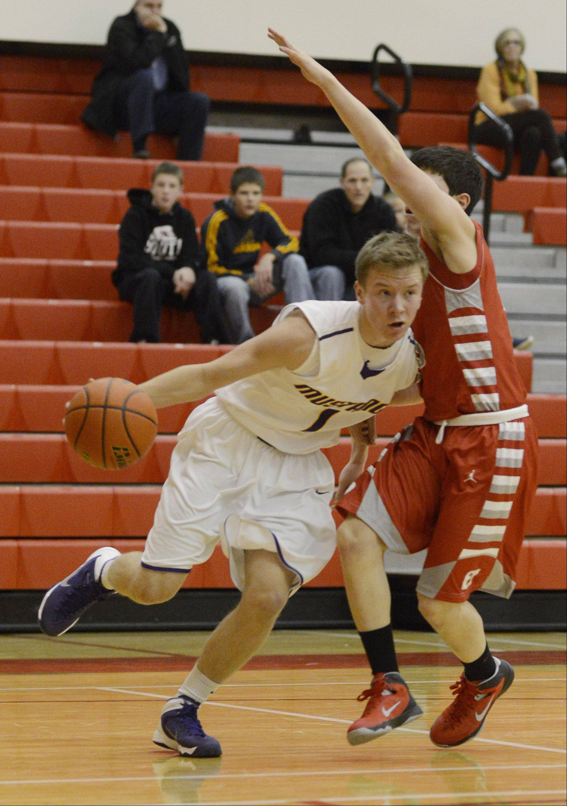 Rolling Meadows' Matt Wojcik drives against Deerfield's Sam Kuznetsky during Tuesday's game in Palatine.