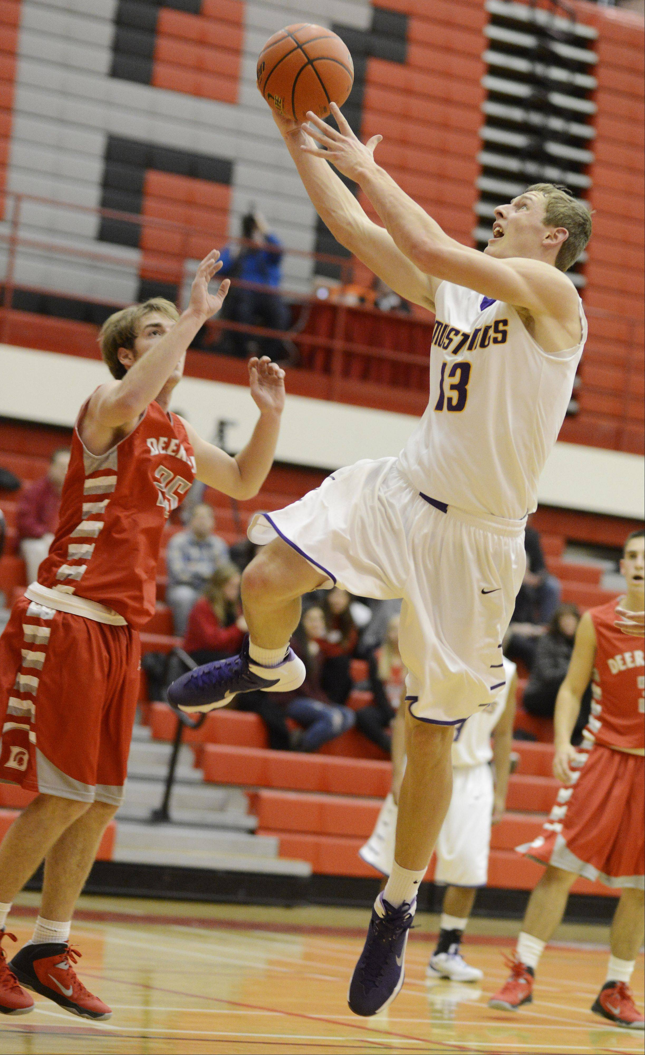 Rolling Meadows' Matt Dolan drives to the basket for a layup during Tuesday's game in Palatine.