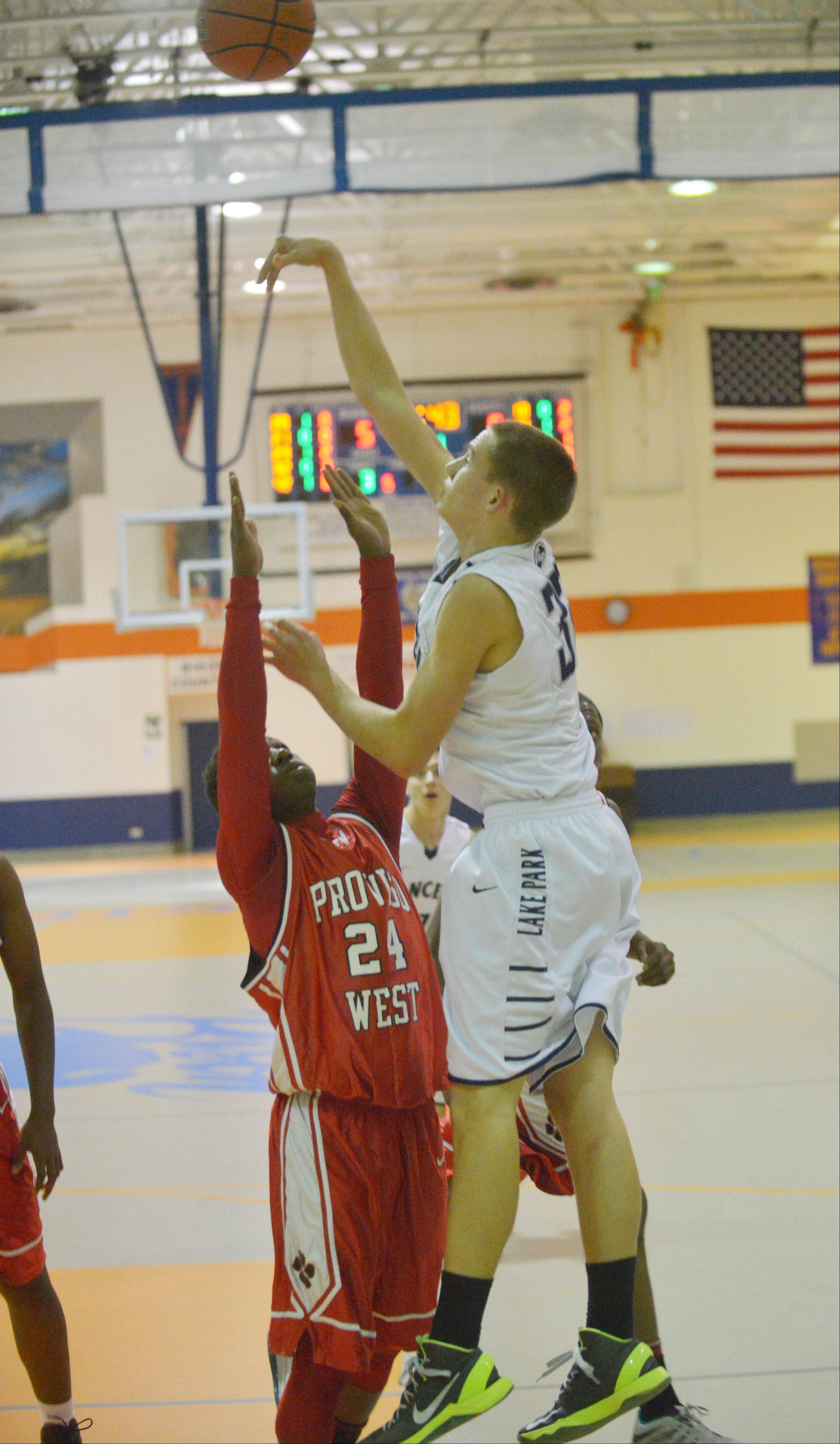 Connor Vance of Lake Park puts up a shot during the Lake Park vs. Proviso West boys basketball game Wednesday.