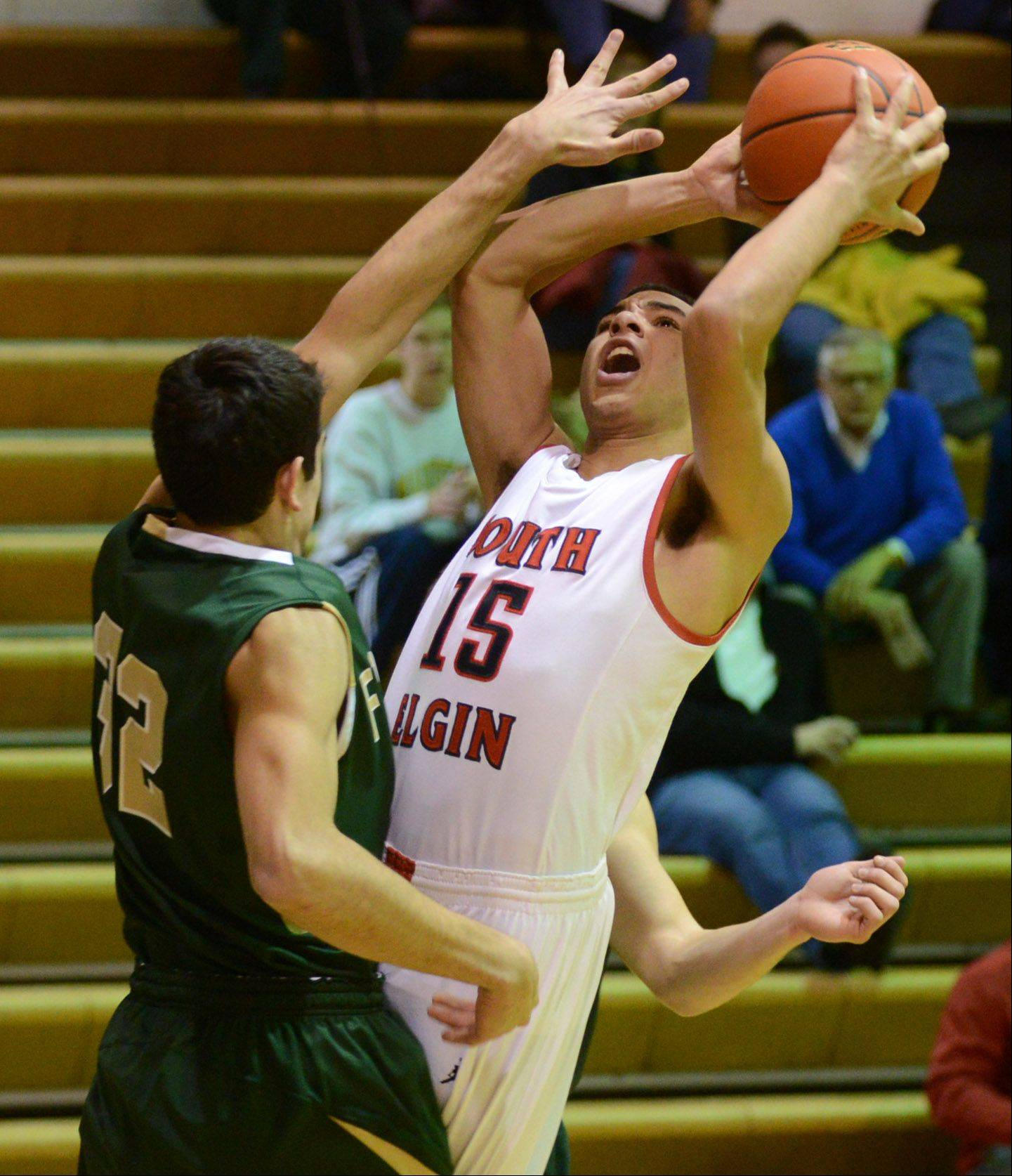 South Elgin's Matthew Smith (15) puts up a shot against Fremd during Wednesday's game at Fenton High School in Bensenville.