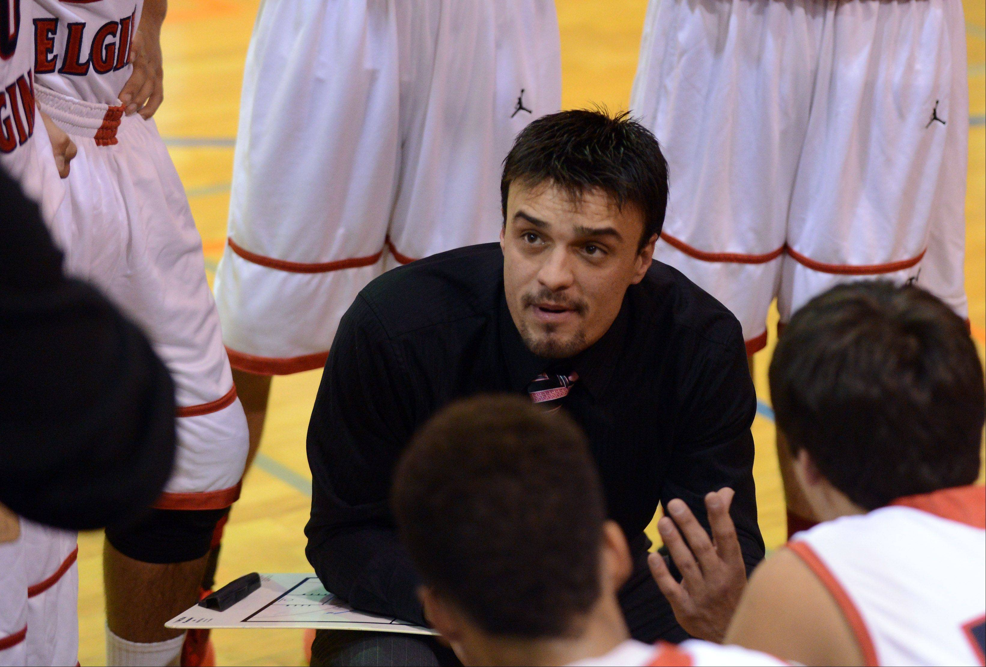 South Elgin coach Matt Peterson talks to his team between quarters against Fremd during Wednesday's game at Fenton High School in Bensenville.