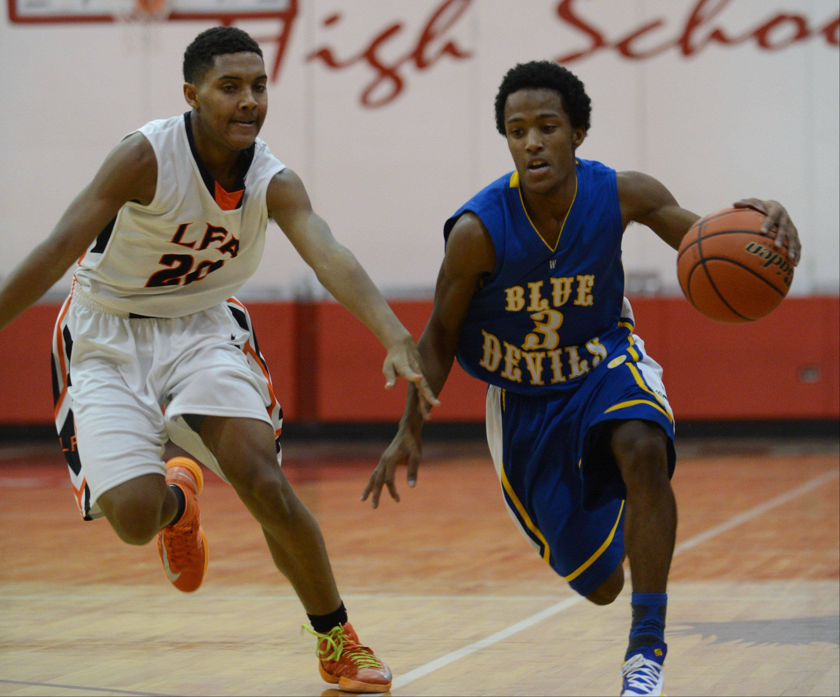 Warren's Eric Gillespie (3) drives past Lake Forest Academy's Isaiah Foust on Wednesday at Mundelein.