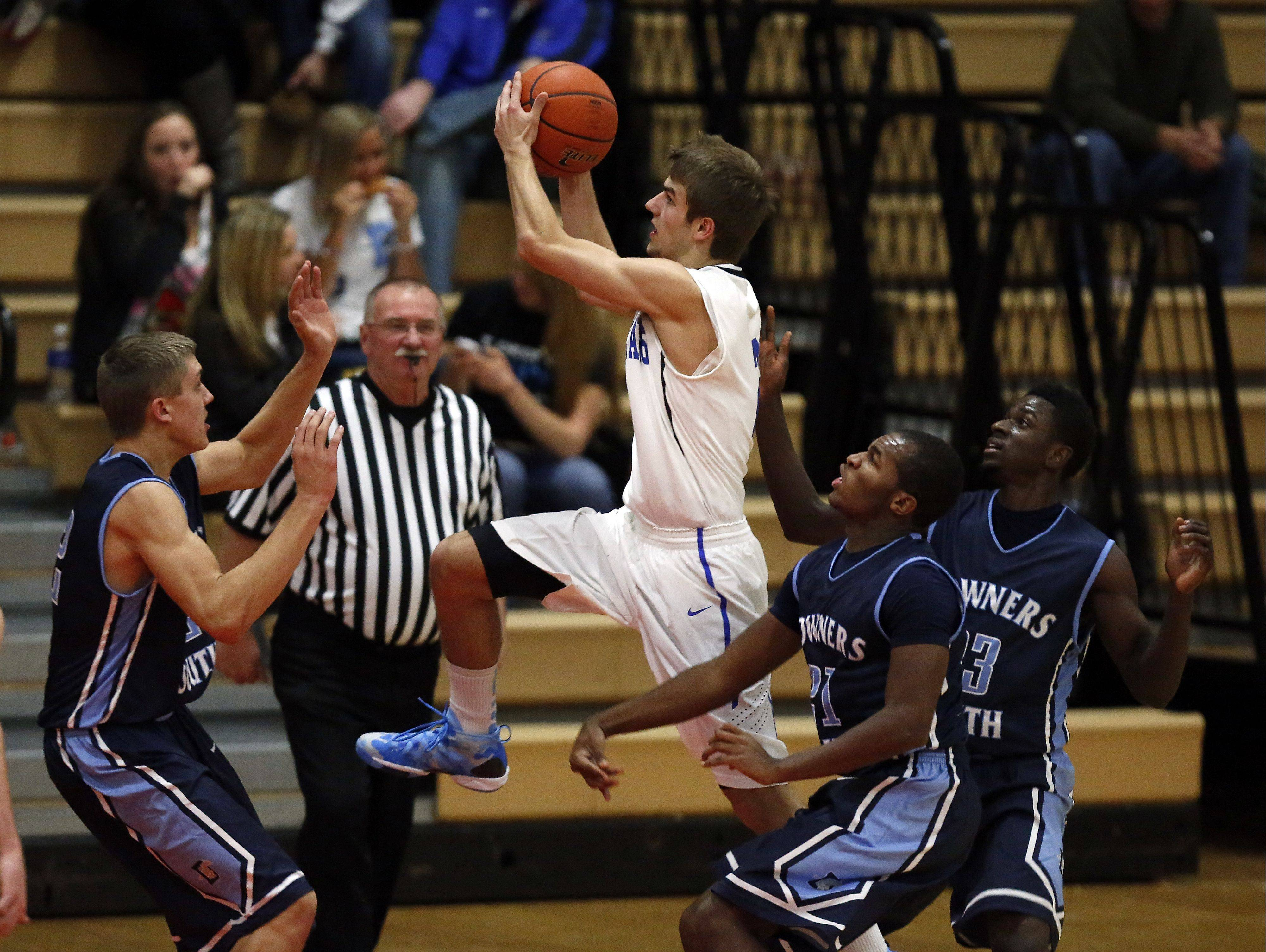 St. Charles North's Jake Ludwig, 2, splits Downers Grove South players TJ Clifford, 42, Javon Turner, 21, and Paul Engo III, 23, during the Ron Johnson Thanksgiving Tournament Friday in St. Charles.