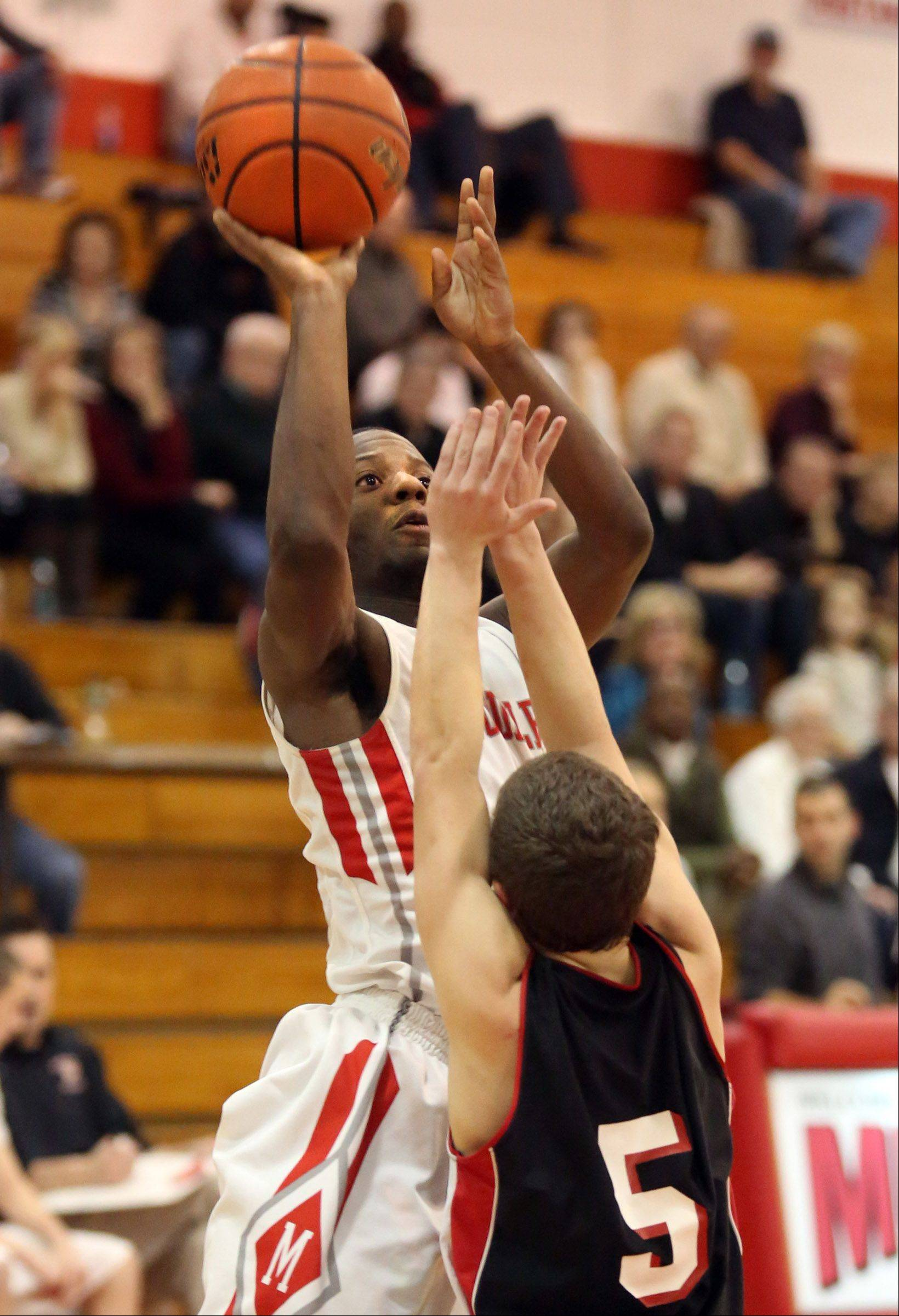 Mundelein guard Nate Willimas sinks a jumper over Barrington defender Jake Orr on Friday at Mundelein.