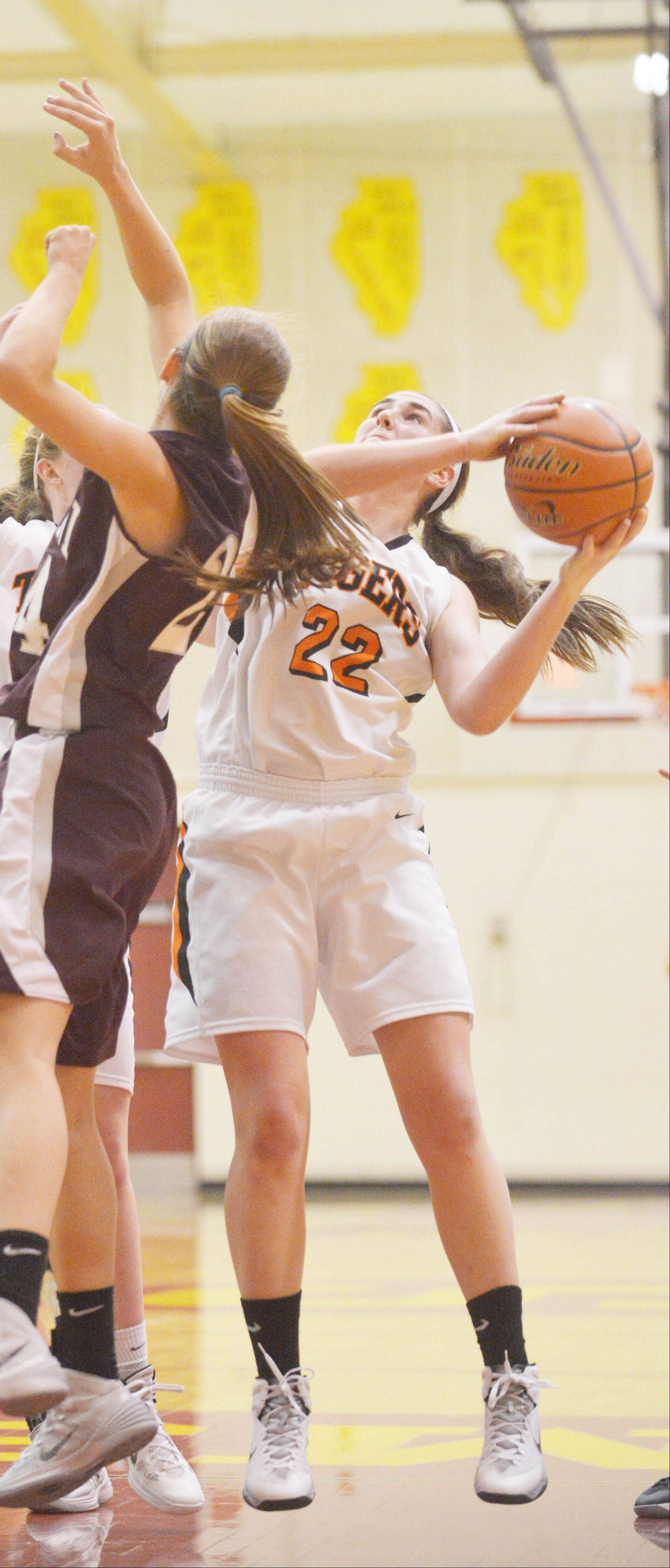 Melinda Franke of Wheaton Warrenville South takes a shot during the Wheaton Warrenville South vs. Montini girls basketball game at the Schaumburg tournament Saturday.