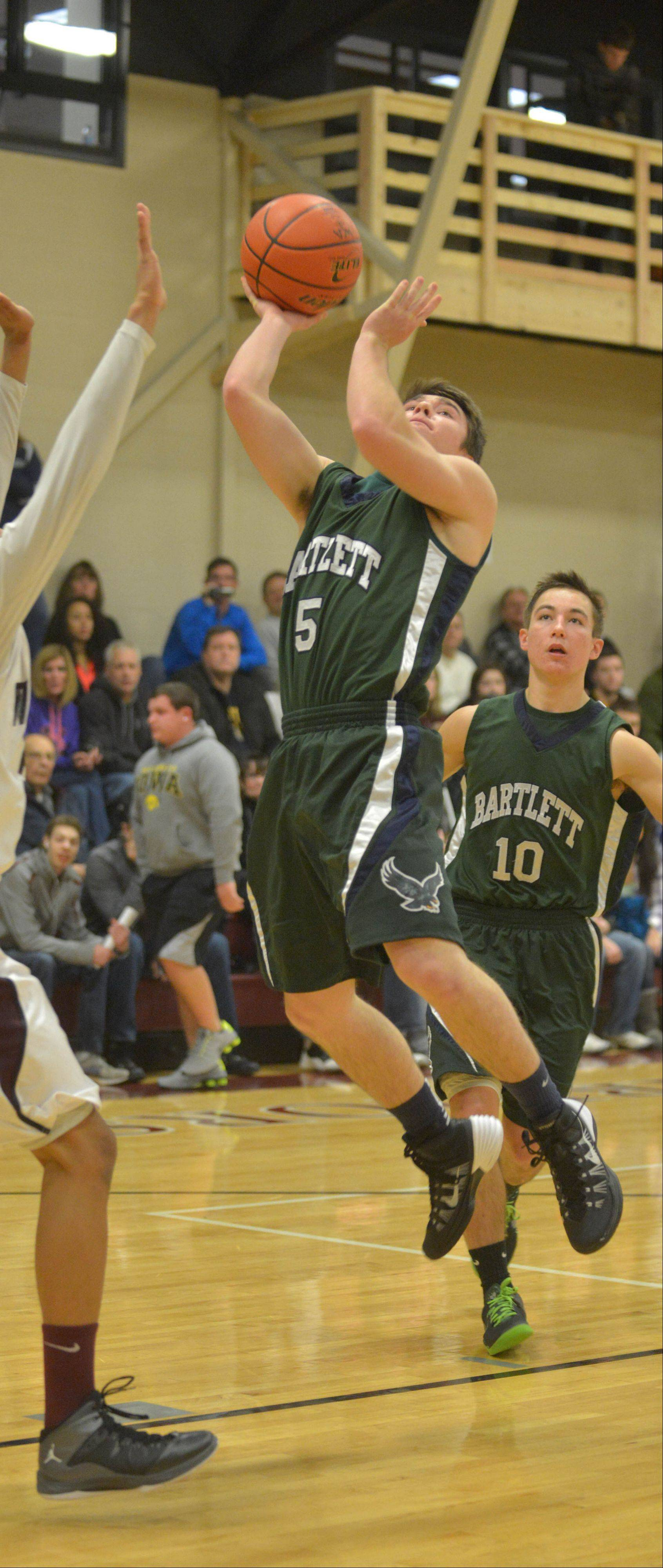 Kevin Wantroba of Bartlett takes a shot at Wheaton Academy Saturday.