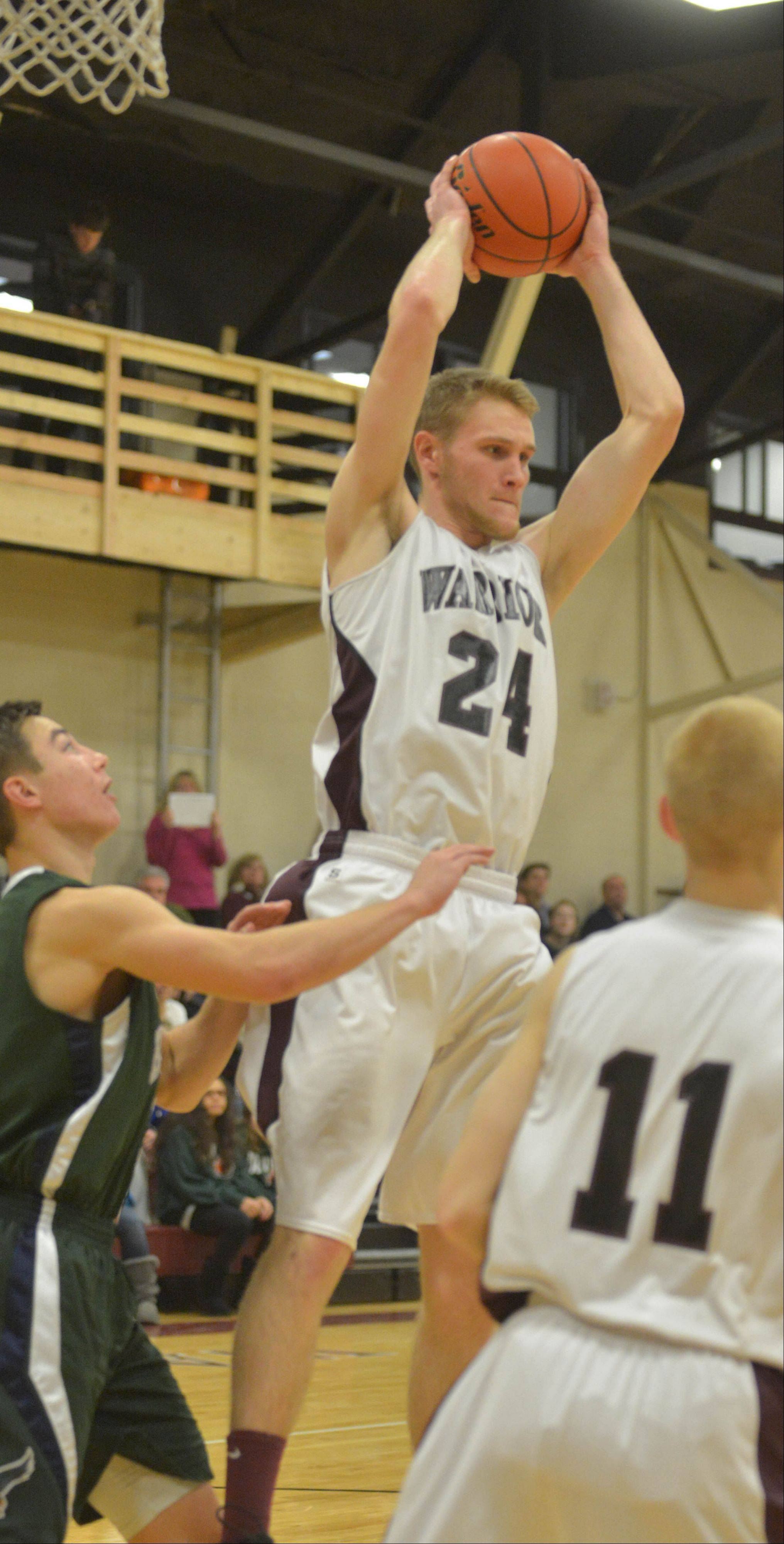 Gordon Behr of Wheaton Academy pulls down a rebound Saturday.