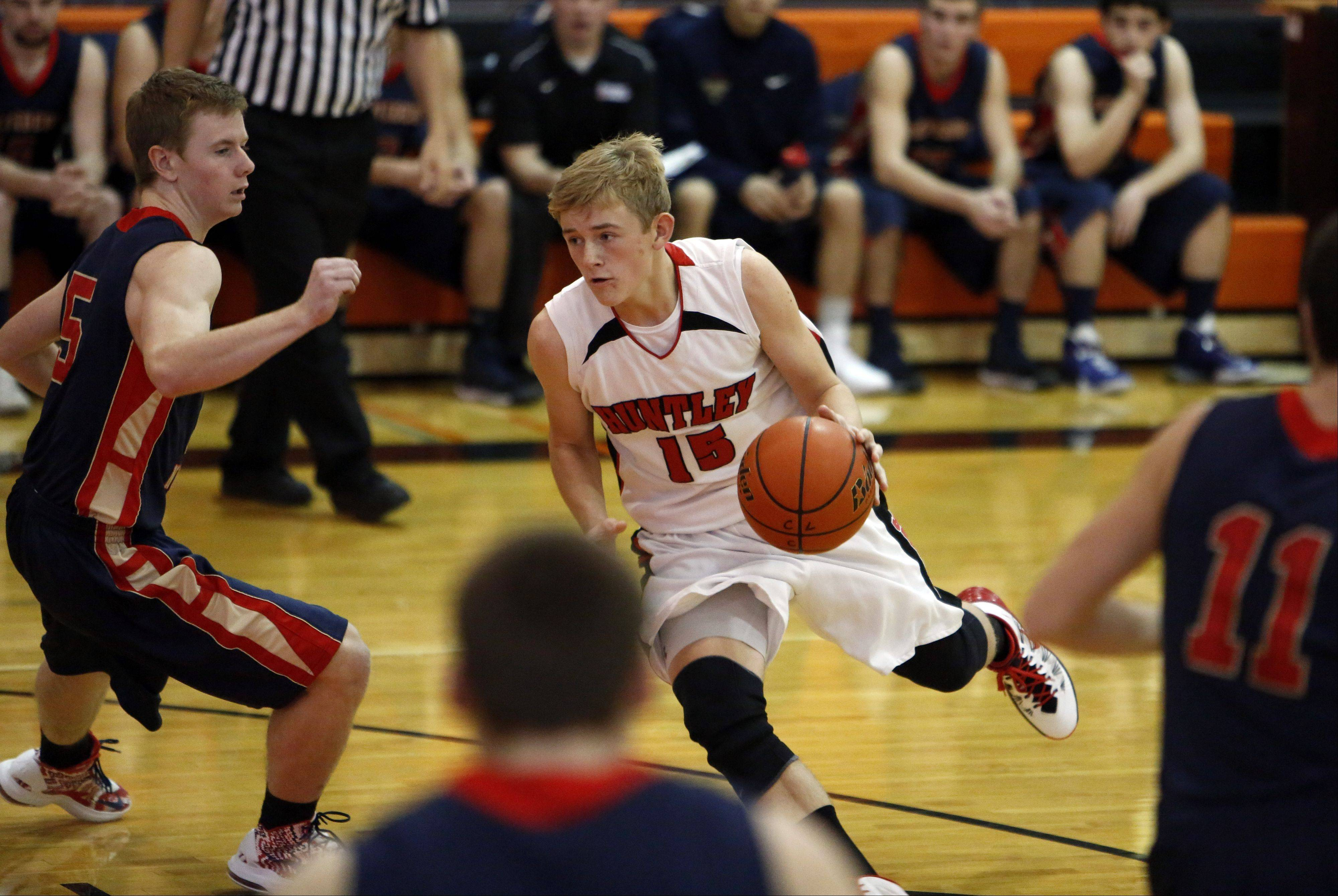 Huntley's Jack Bessey drives to the hoop around Belvidere North's Hunter Blake during the Crystal Lake Central High School Coaches vs, Cancer Thanksgiving Tourney Saturday in Crystal Lake.