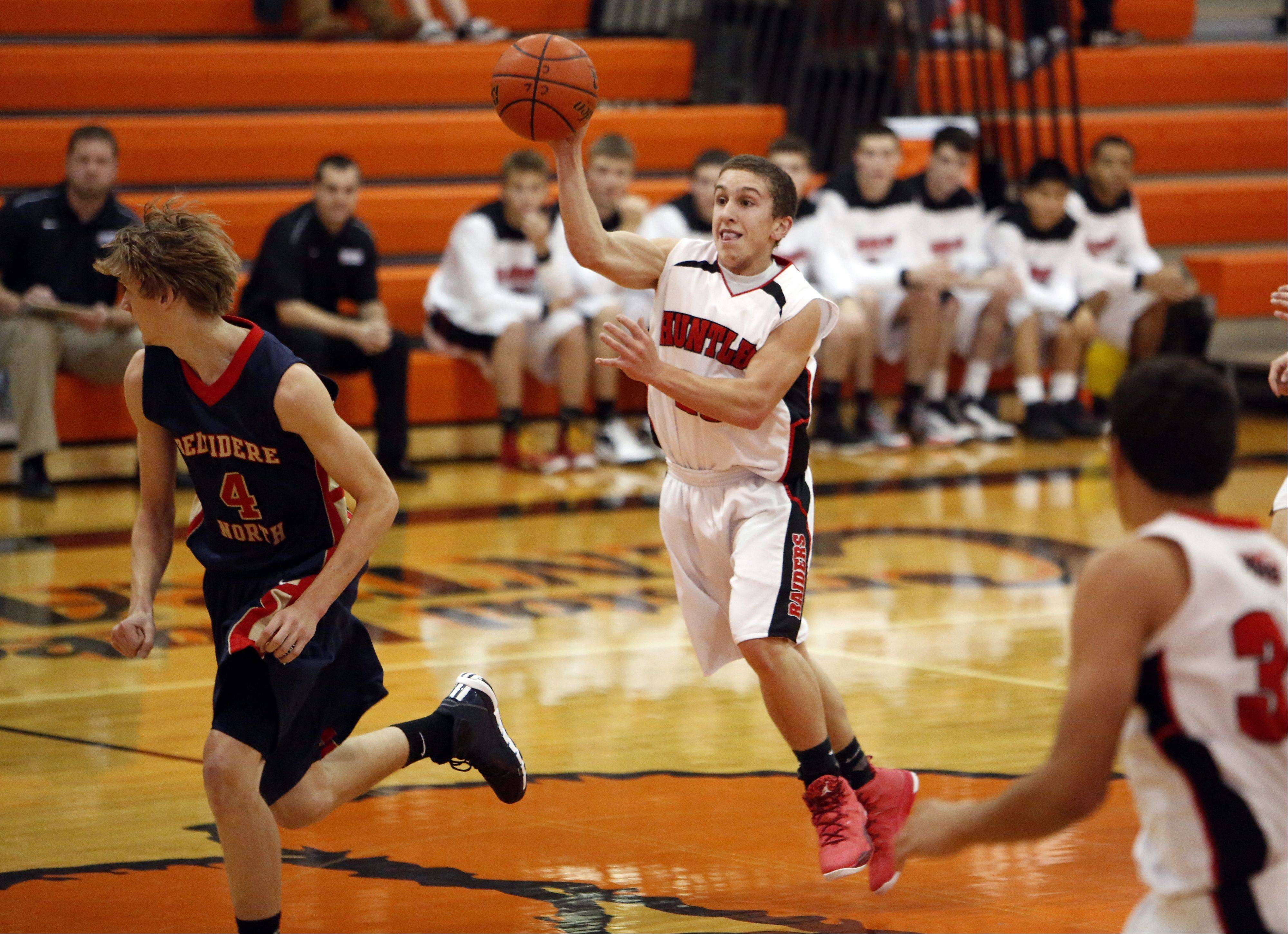 Huntley's Kyle Slonka (23) looks for an open teammate during the Crystal Lake Central High School Coaches vs. Cancer Thanksgiving Tourney Saturday in Crystal Lake.