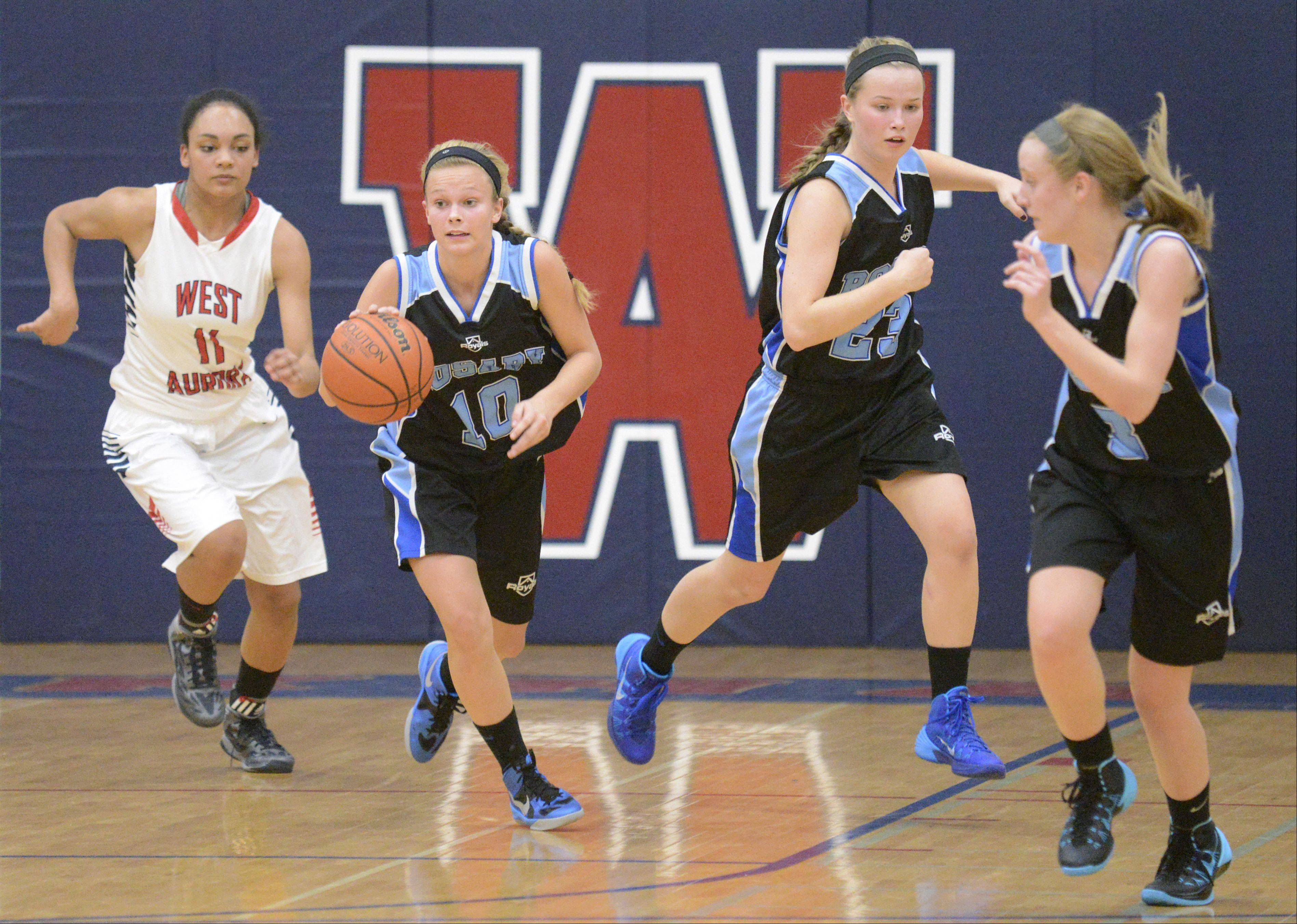 Rosary's Quincy Kellett takes off with the ball in the second quarter on Tuesday, December 3.