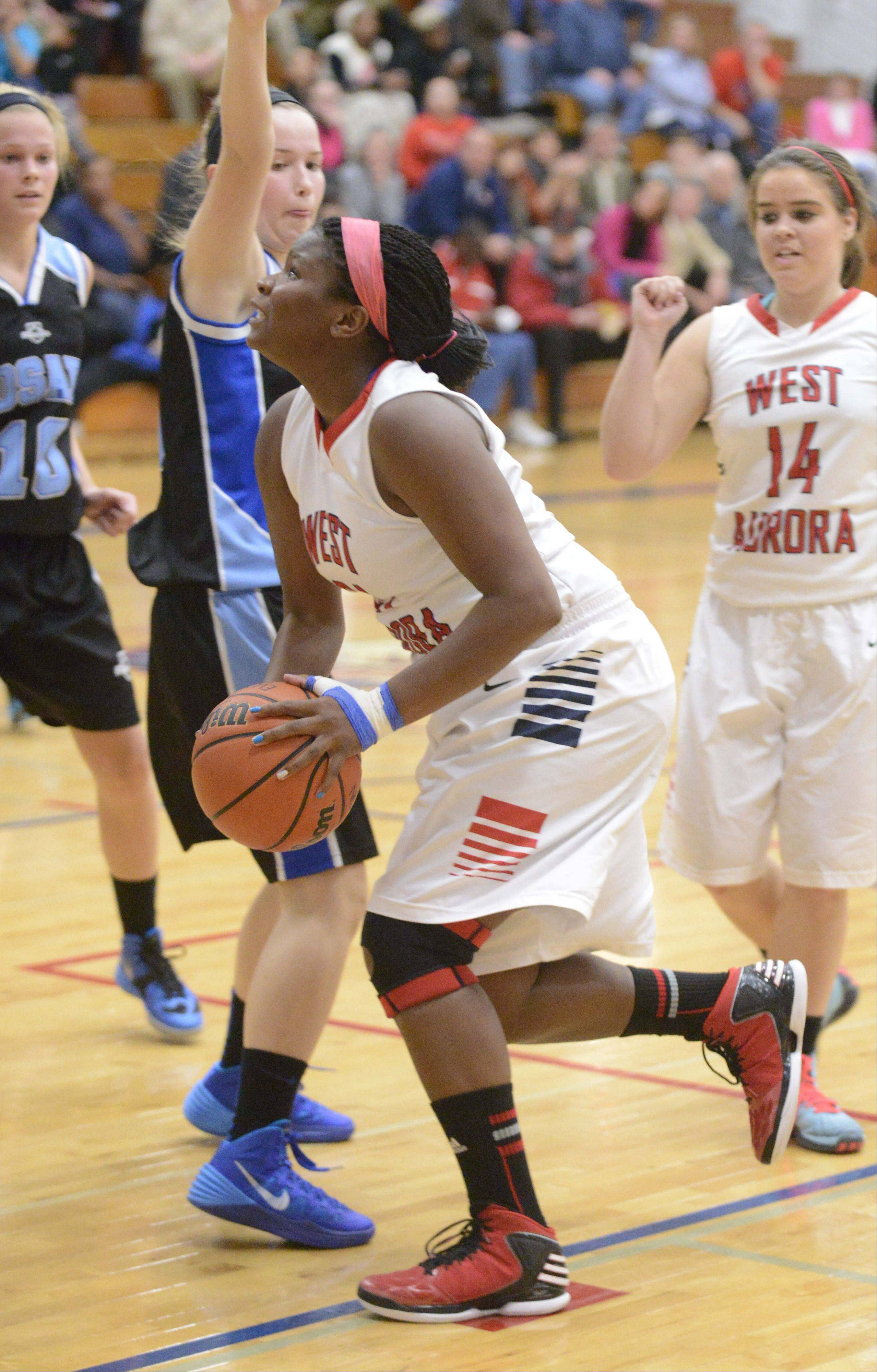 Images from the Rosary vs. West Aurora girls basketball game Tuesday, December 3, 2013.