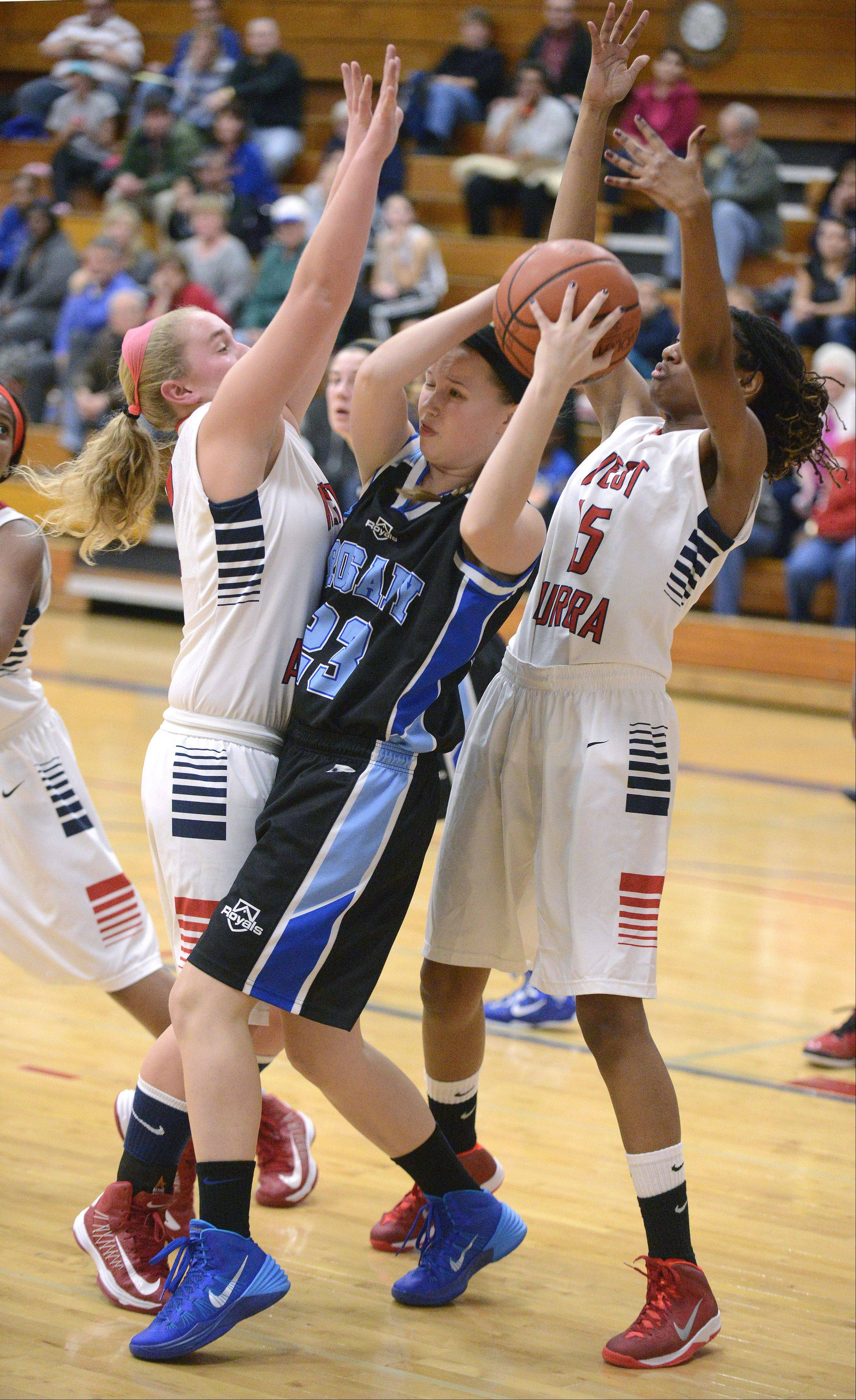 Rosary's Taylor Drozdowski is smothered by West Aurora's Carly Frauenhoff and Natalee DeJohnette.