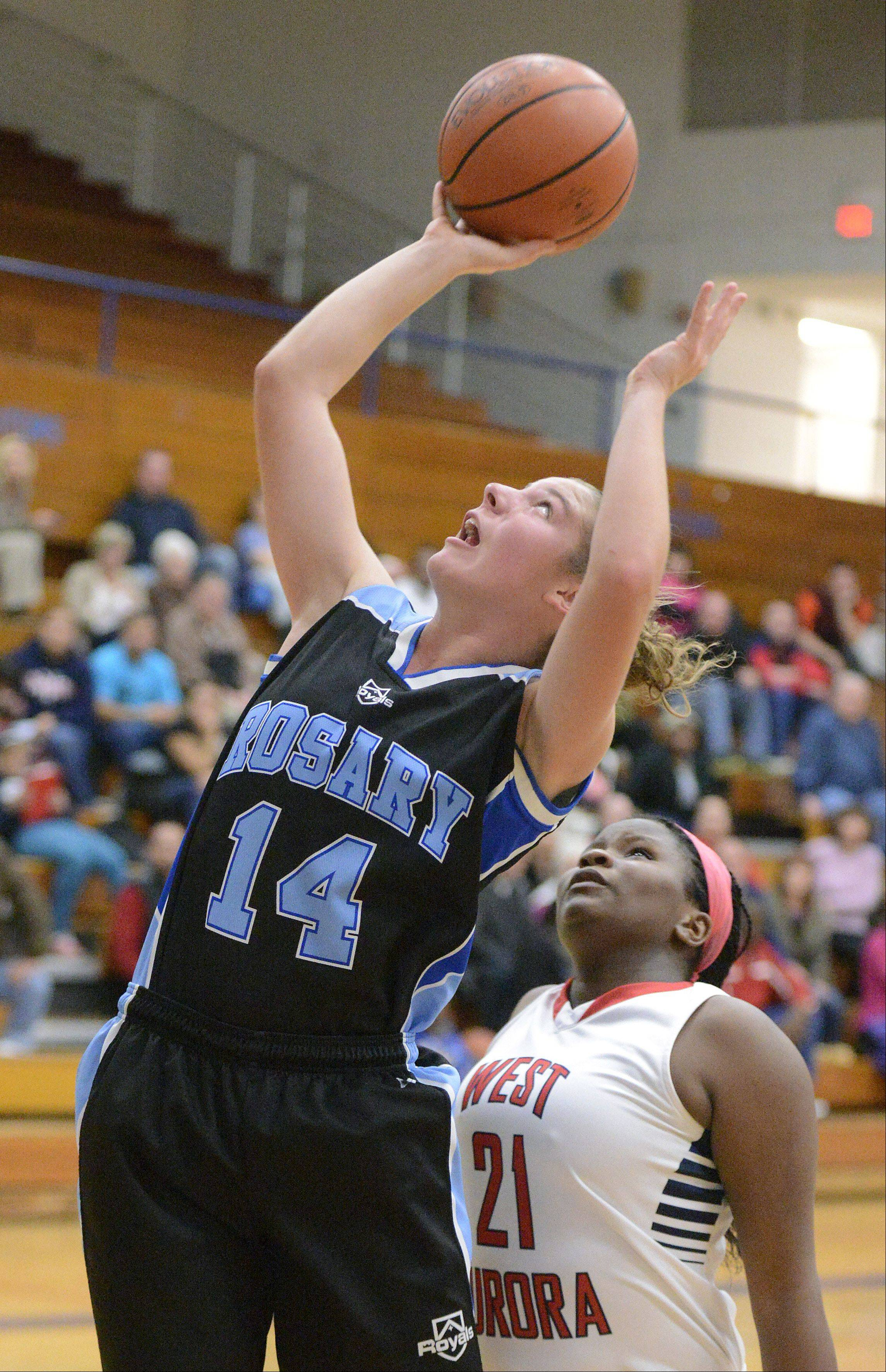 Rosary's Megan Conlin shoots for the hoop under West Aurora's Elizabeth Skaggs.