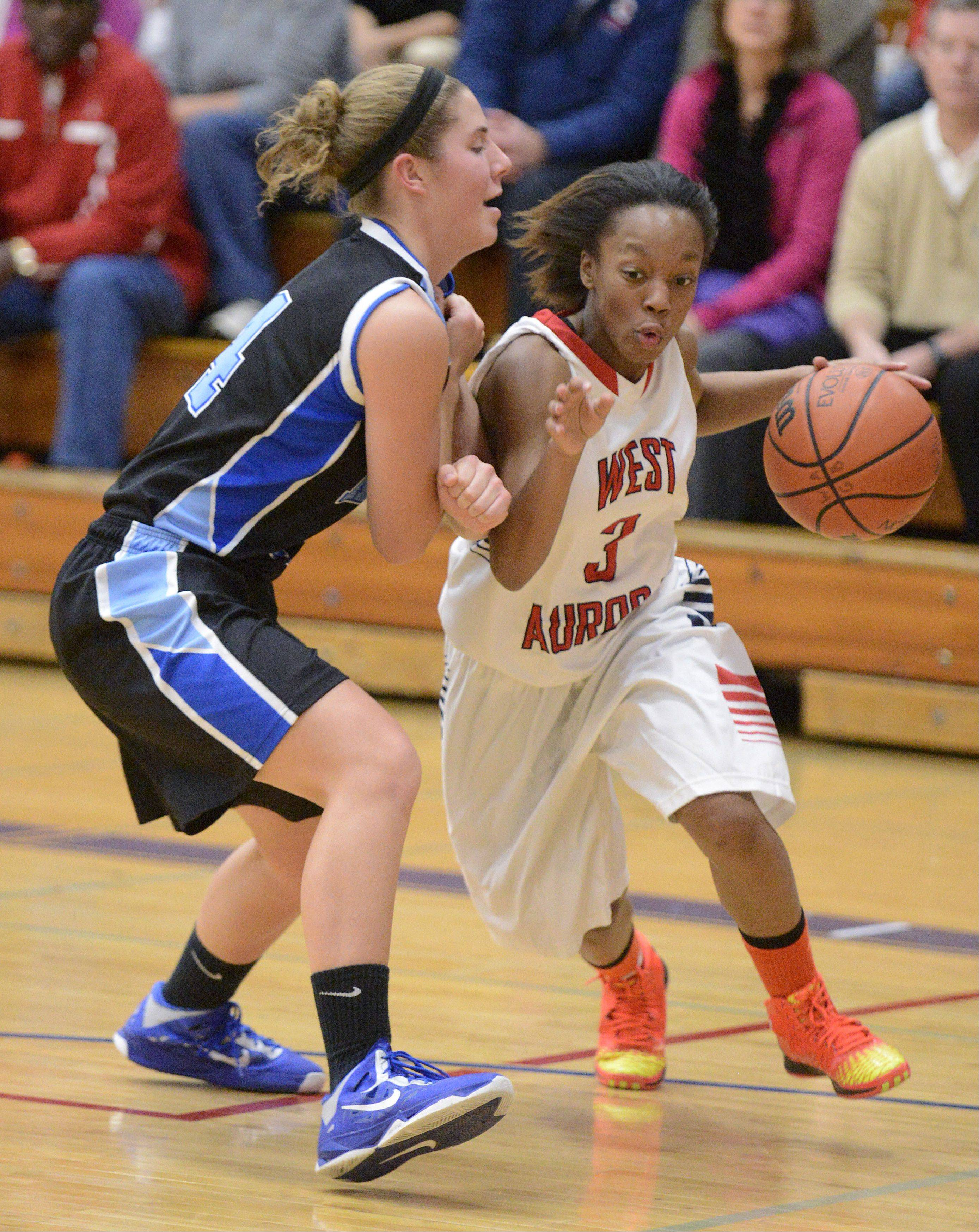 Rosary's Megan Conlin guards West Aurora's Alexis Wiggins.