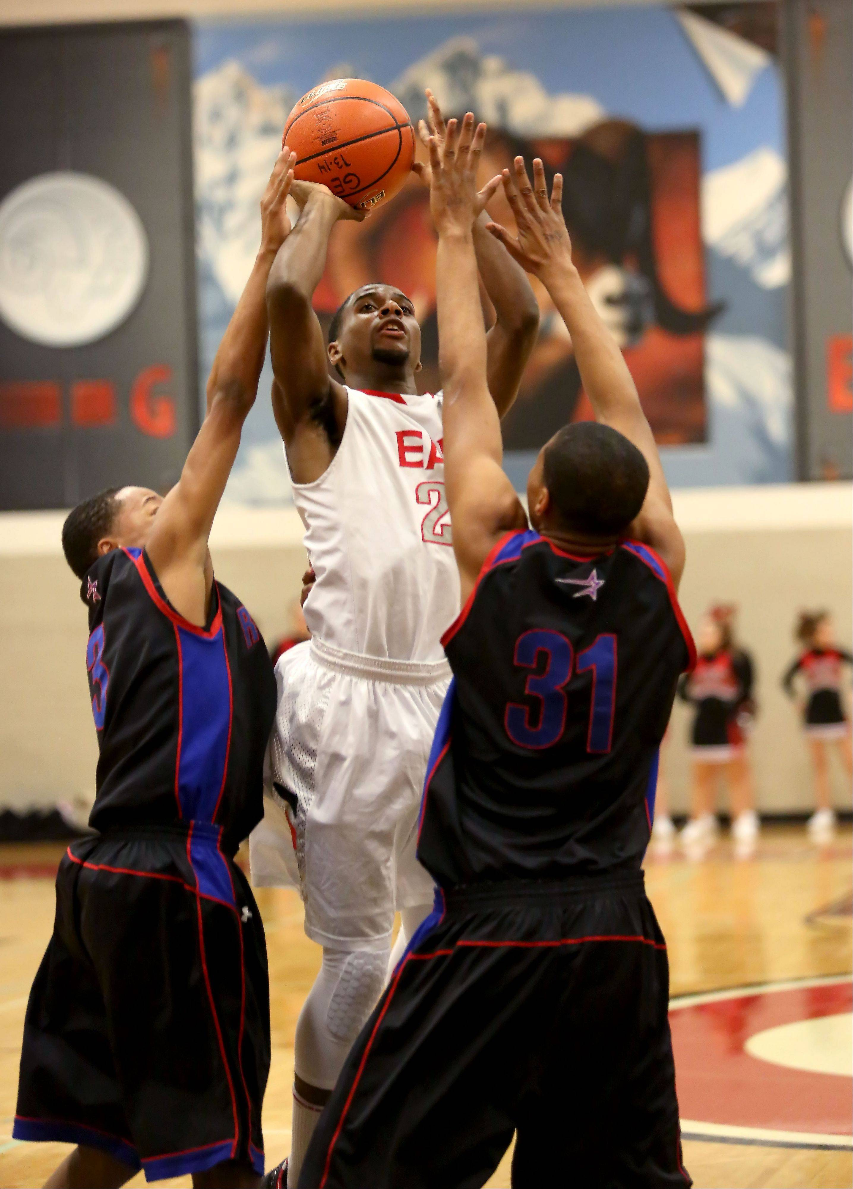 Jaron Hall of Glenbard East attempts a shot through the Rich South defense.