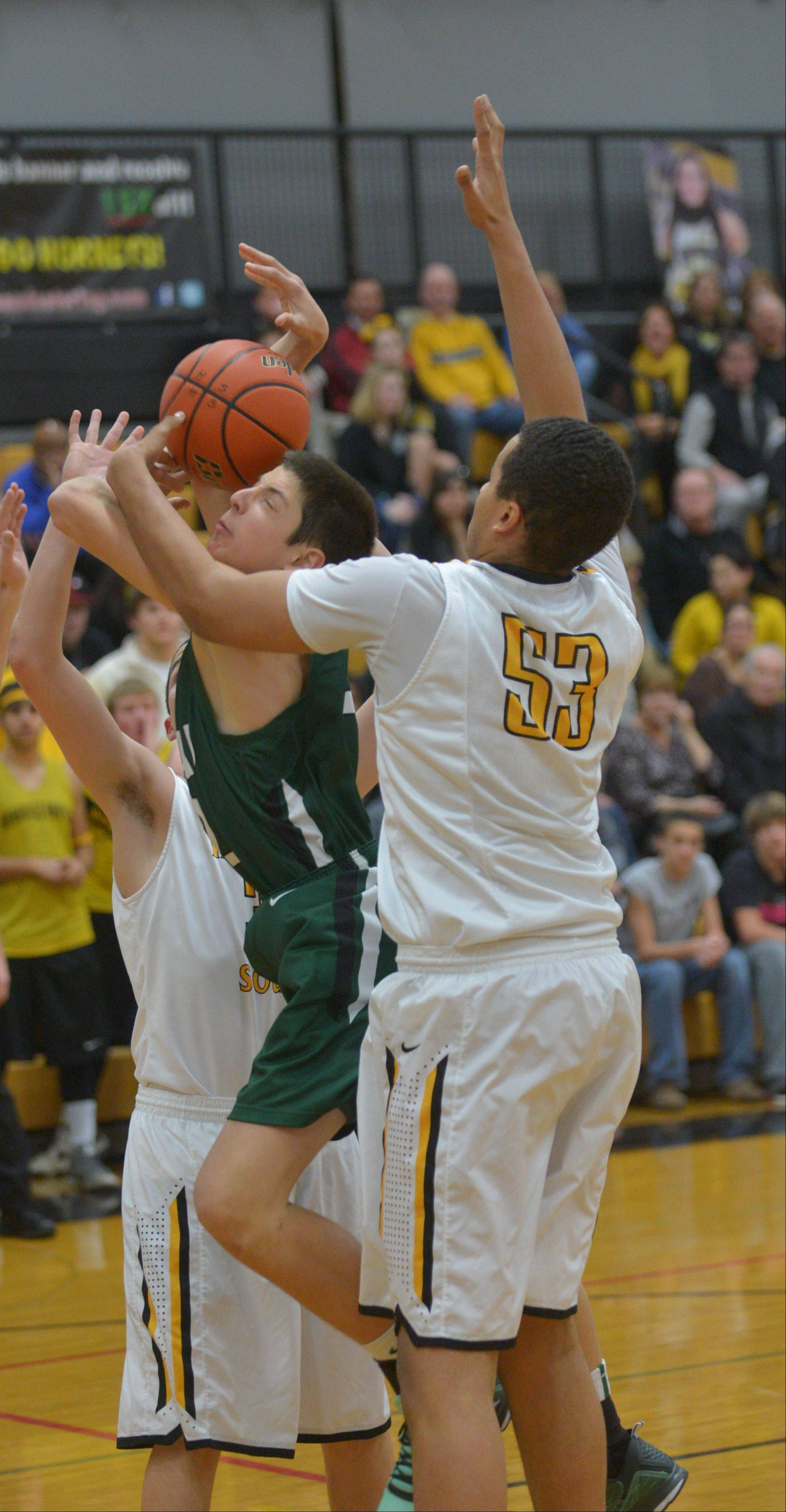 Justin Pierce of Glenbard West takes one to the net while Barrett Benson of Hinsdale South attempts to block during the Glenbard West at Hinsdale South boys basketball game Wednesday.