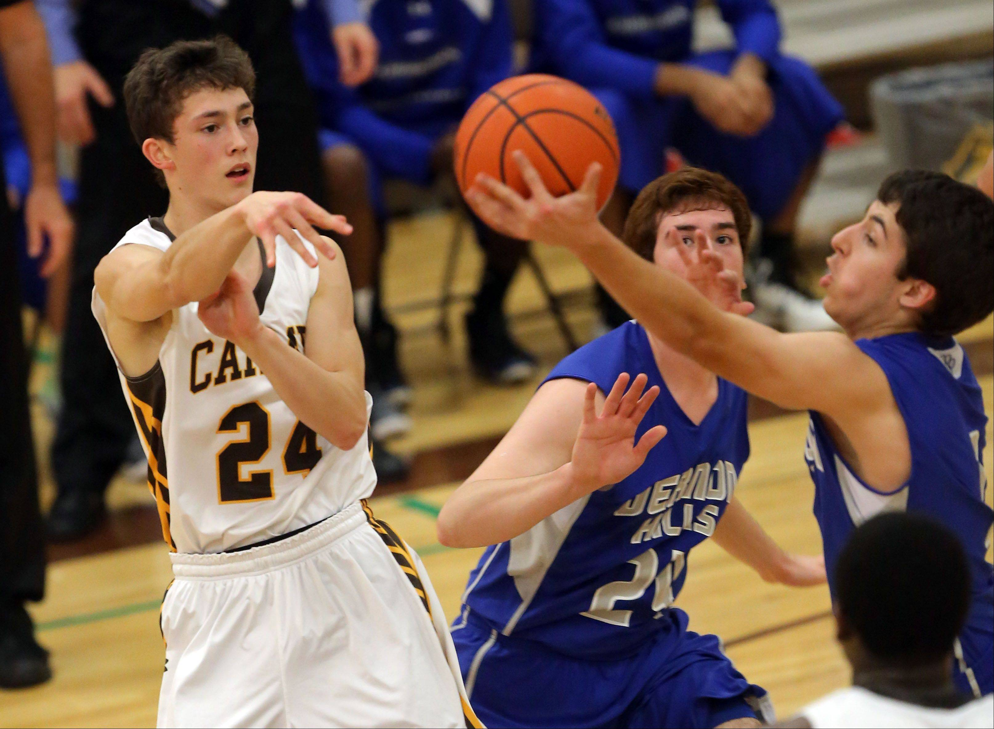 Carmel's Billy Kirby, left, tries to pass around Vernon Hills' Robby Nardini on Wednesday night at Carmel Catholic.