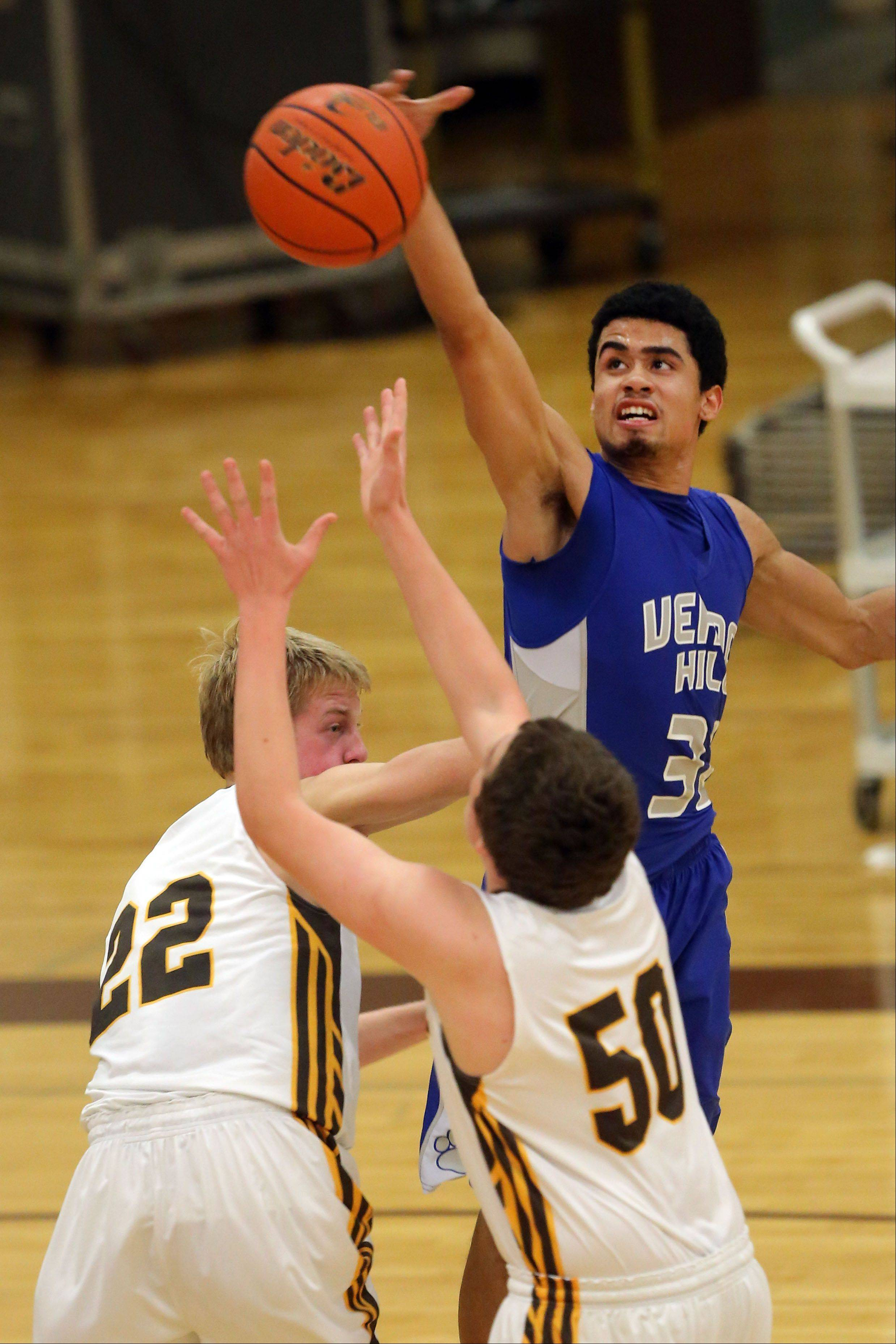 Vernon Hills' Lem Turner, right, blocks the shot of Carmel's Lee Bowen on Wednesday night at Carmel Catholic.