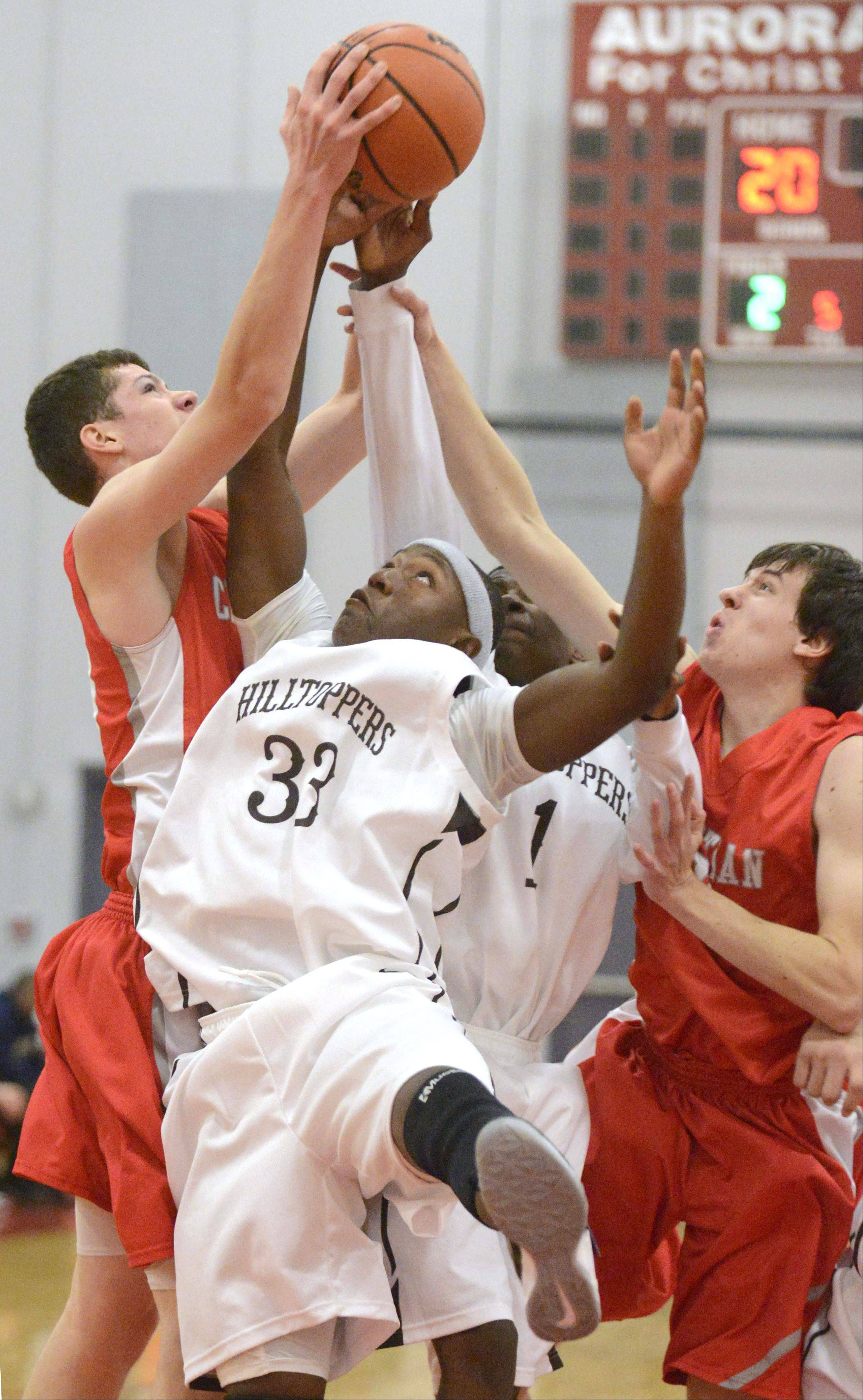 Images from the Joliet Catholic vs. Aurora Christian boys basketball game Wednesday, December 4, 2013.