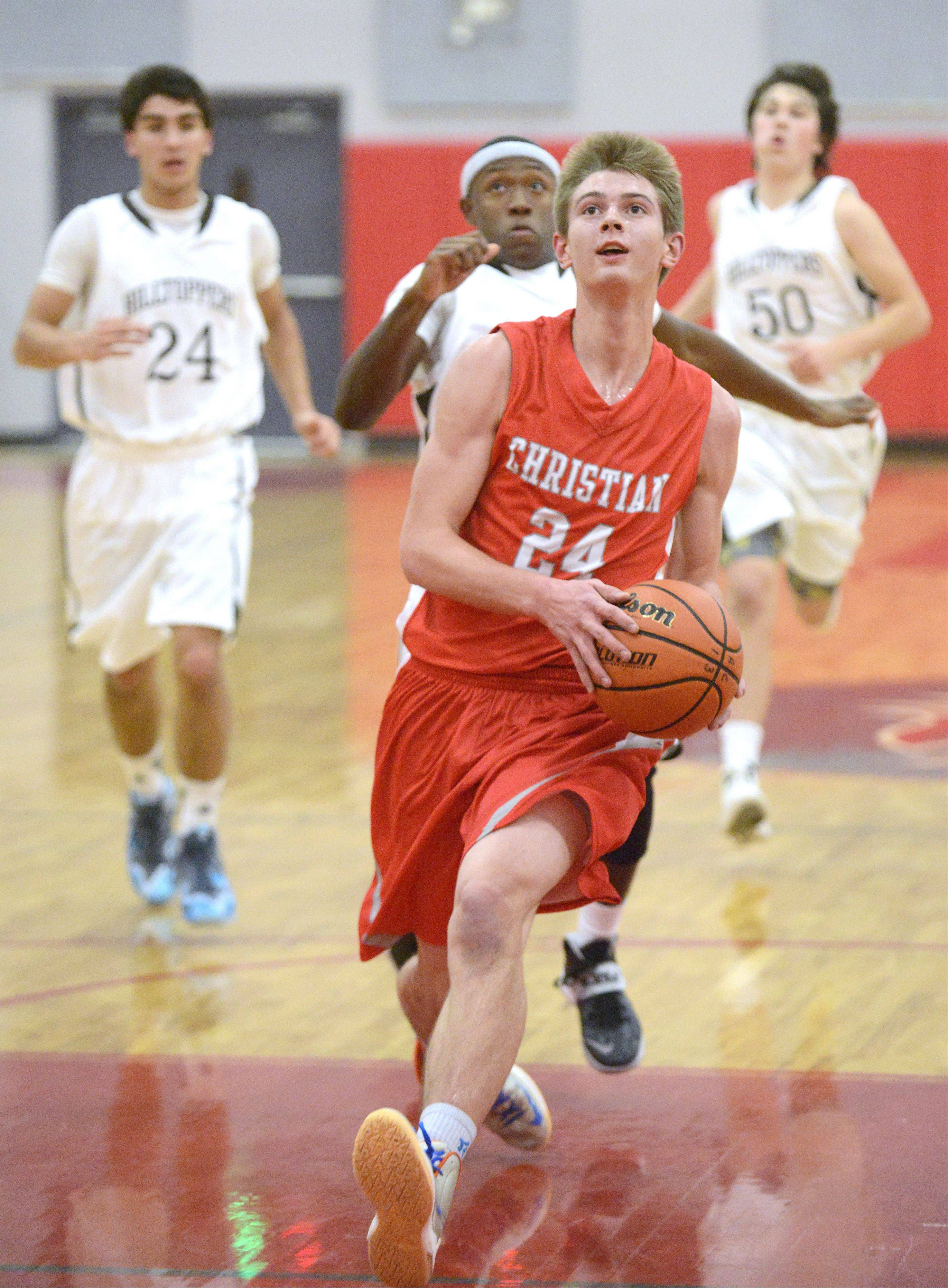 Aurora Christian's Wes Wolfe sprints for the hoop on a clear path in the second quarter.