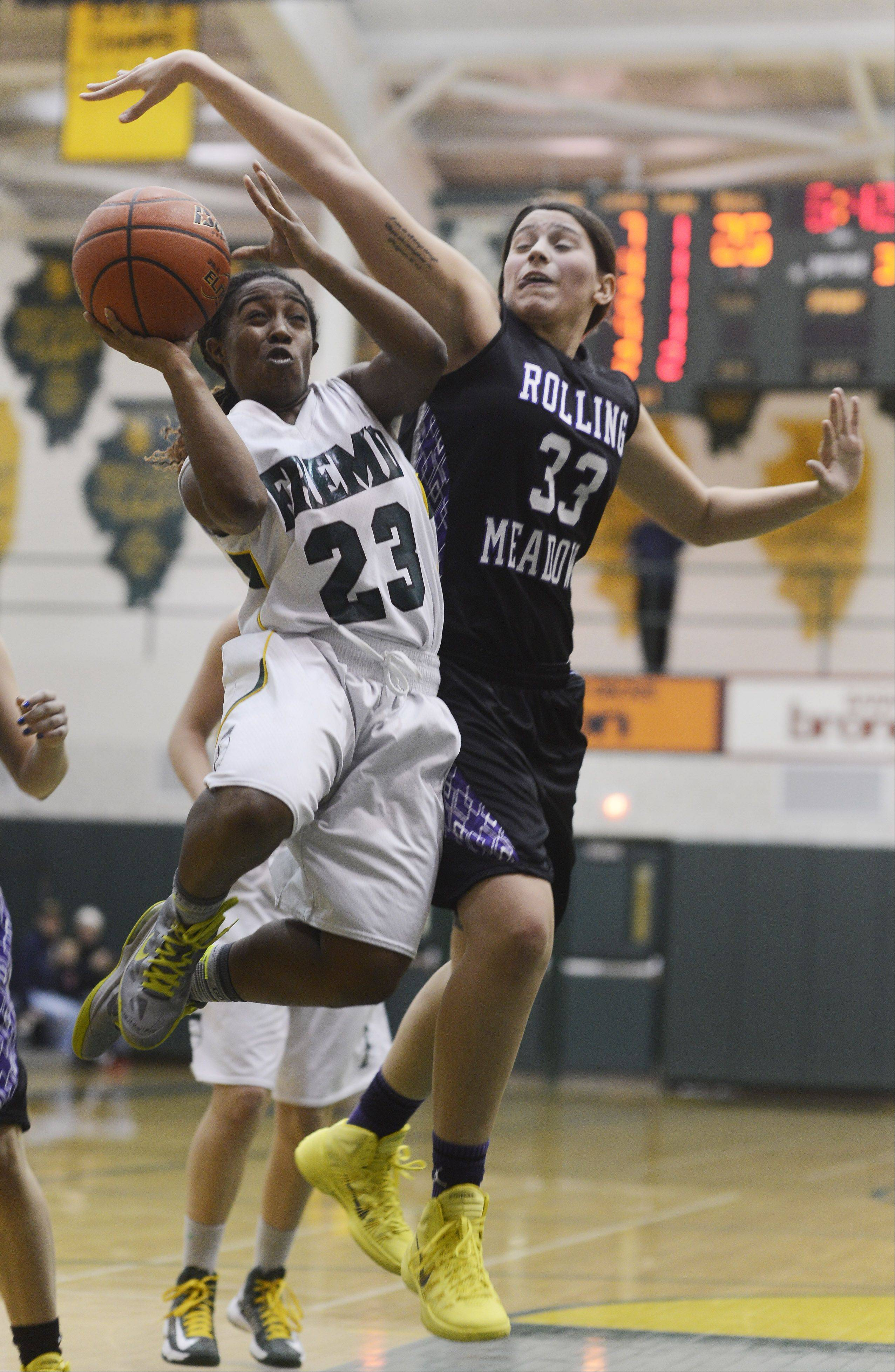 Fremd's Brianna Lewis, left, tries to drive past Rolling Meadows defender Ashley Montanez during Tuesday's game.