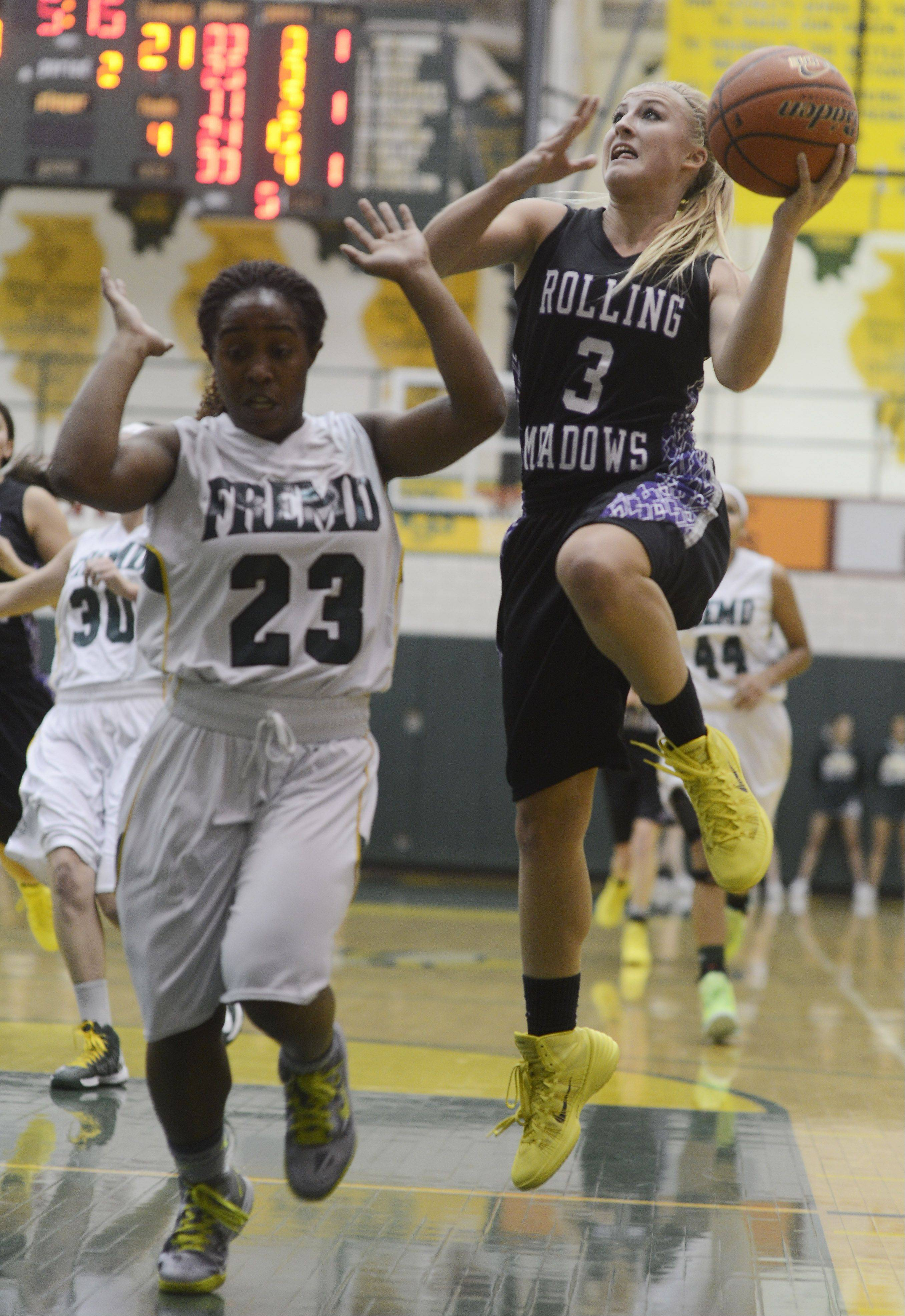 Fremd's Brianna Lewis, left, tries to avoid contact with Rolling Meadows' Jackie Kemph during Tuesday's game.