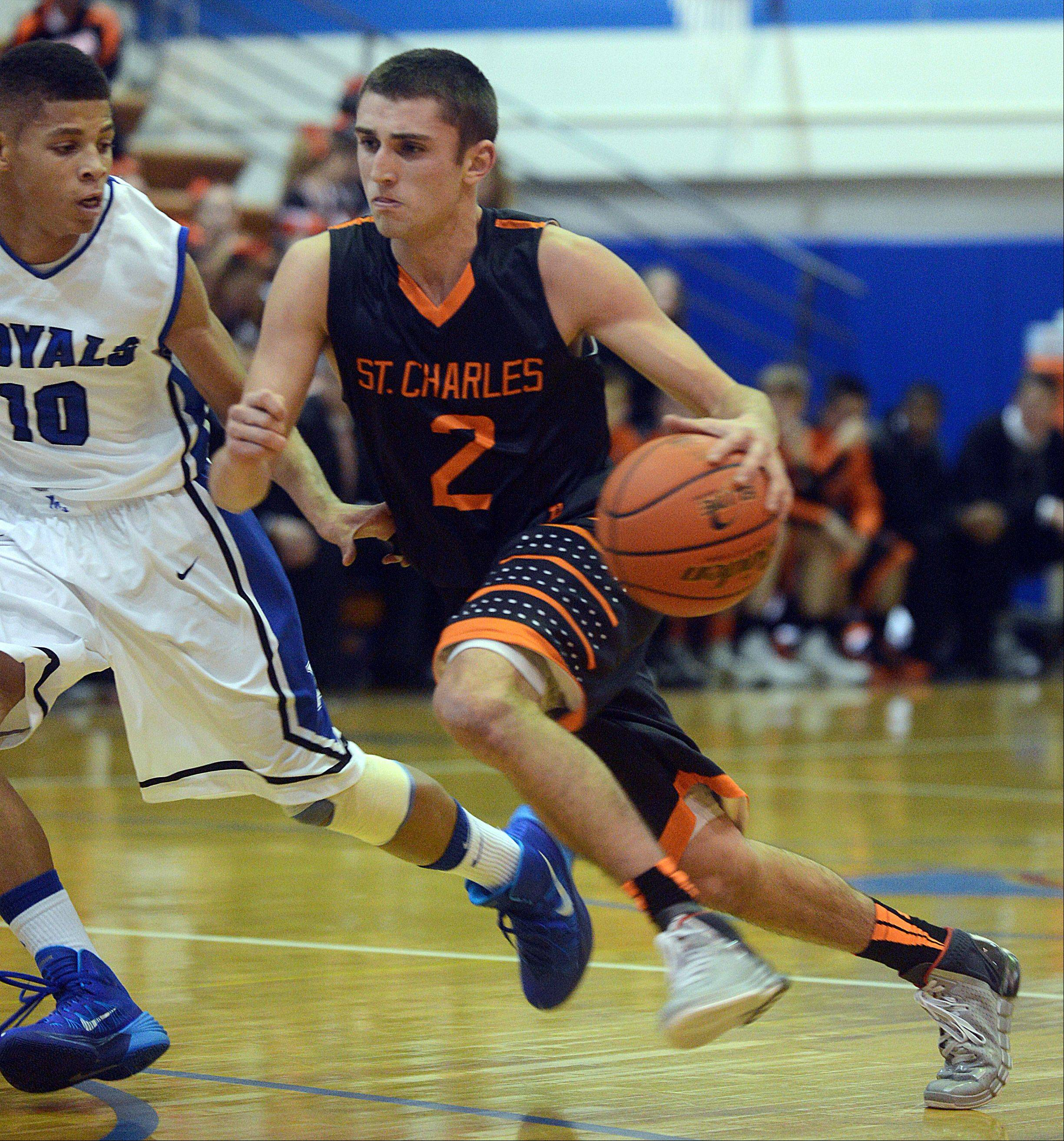St. Charles East's Dom Adduci, right, drives around Larkin's Kendale McCullum Thursday night.