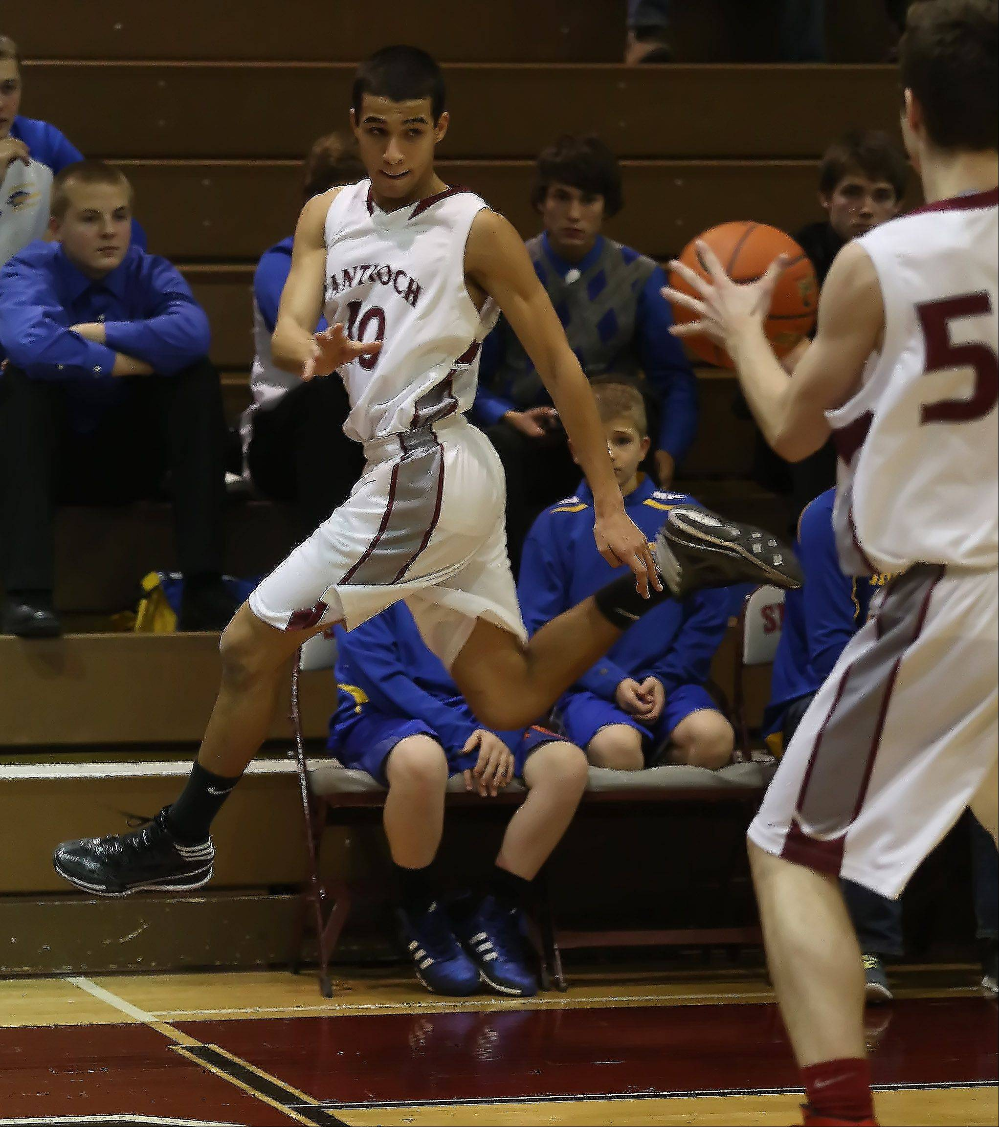 Antioch guard Hamza Abdellatif throws the back inbounds to Antioch forward Matthew Powers.