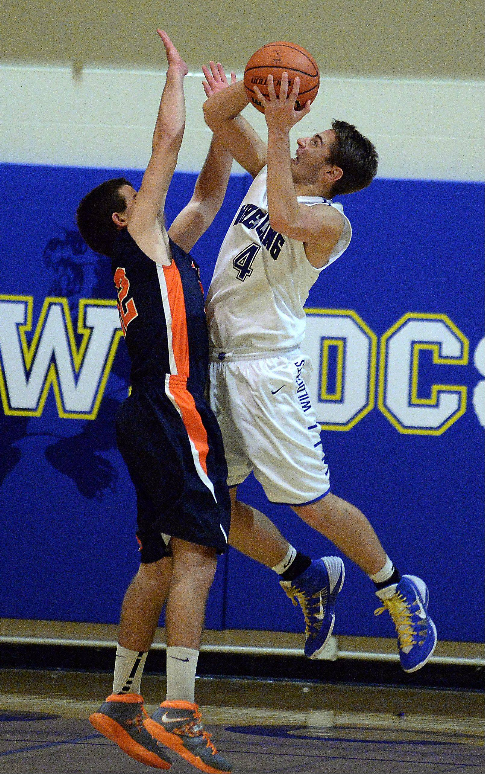 Wheeling's Jeremy Stephani goes up against Buffalo Grove's Ryan Williams in the second half of action Friday at Wheeling.