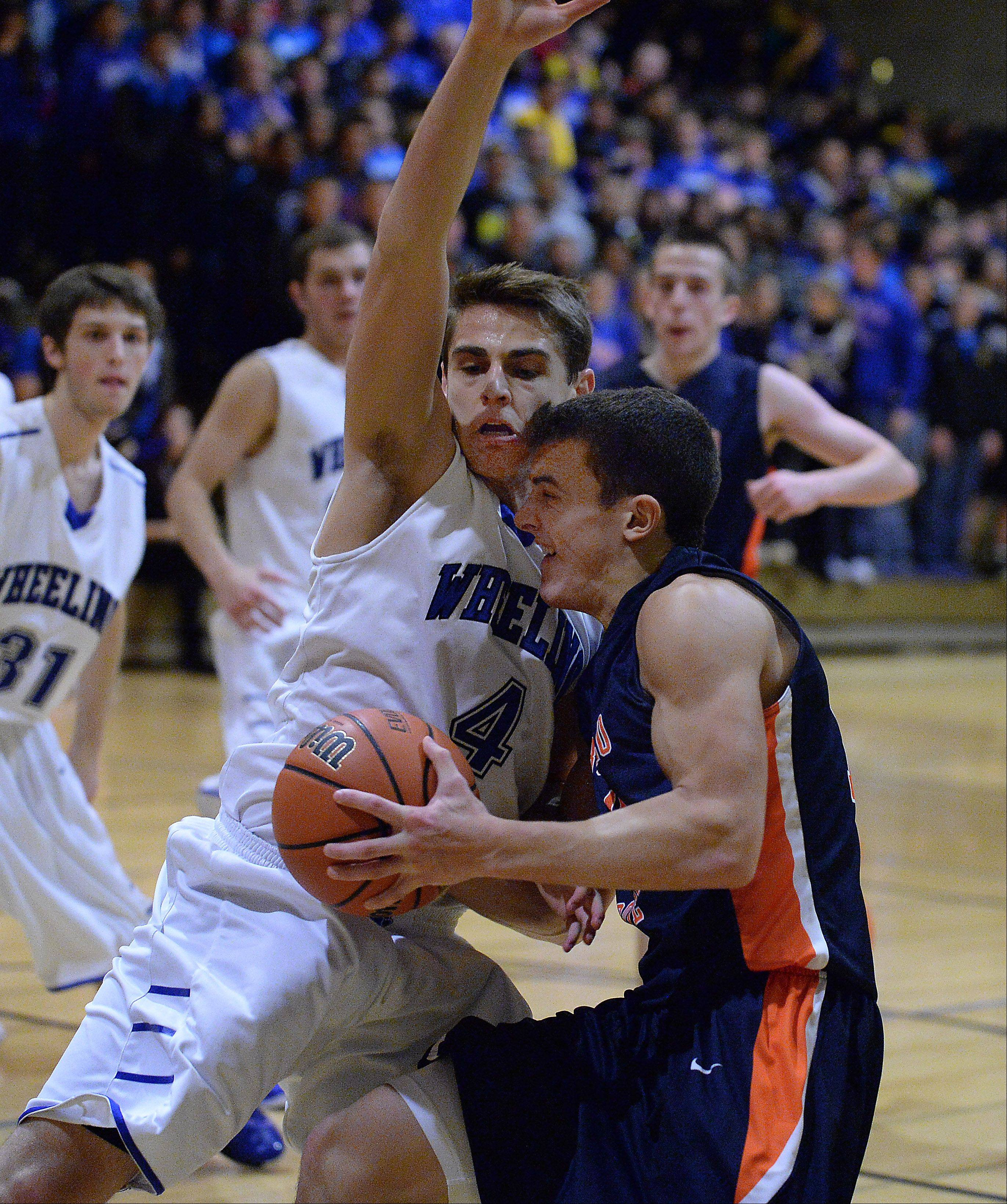 Wheeling's Jeremy Stephani blocks the path of Buffalo Grove's Andrew Apel in the second half at Wheeling on Friday.