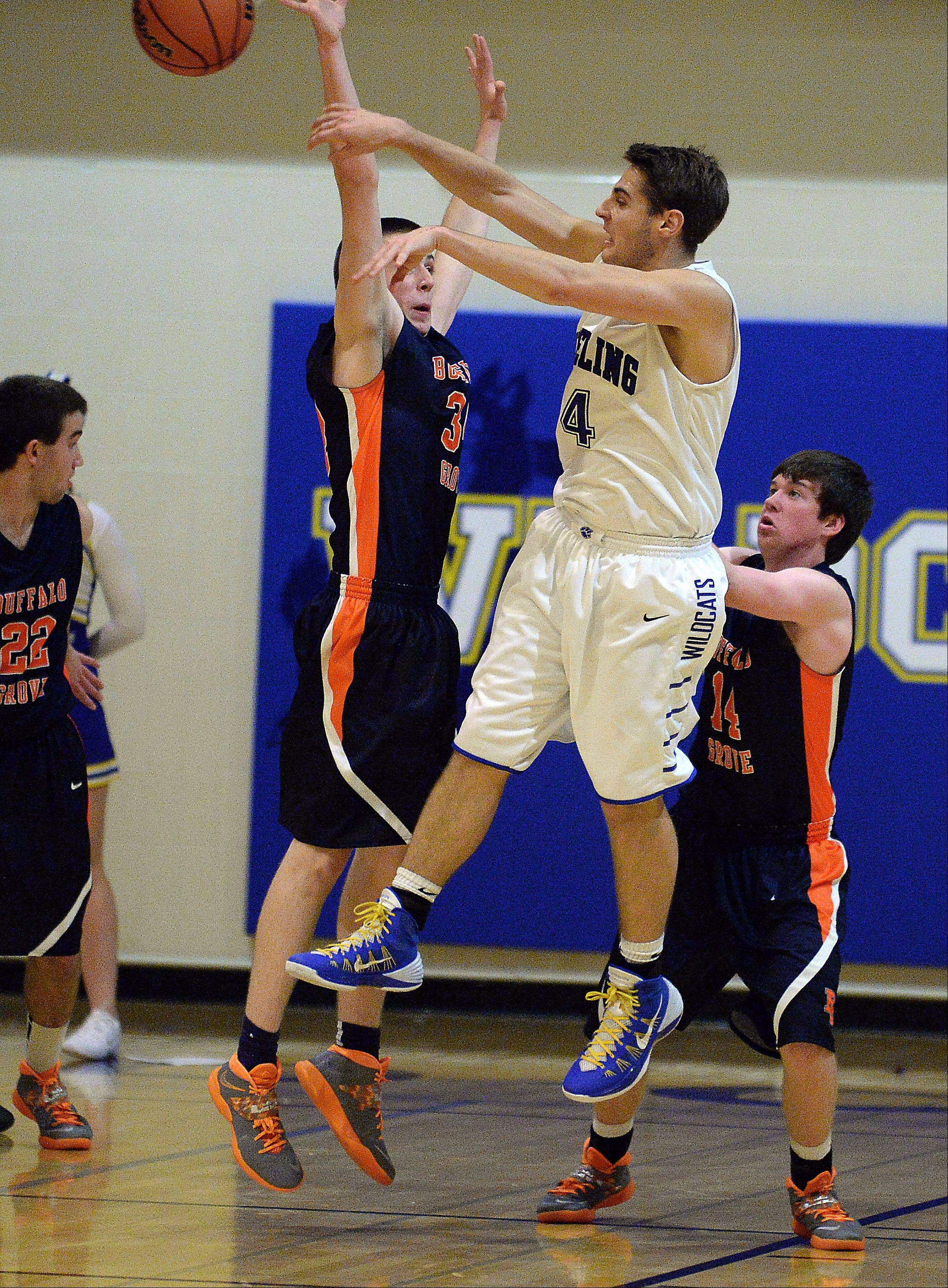 Wheeling's Jeremy Stephani passes off as Buffalo Grove's David Warden applies pressure in the second at Wheeling.
