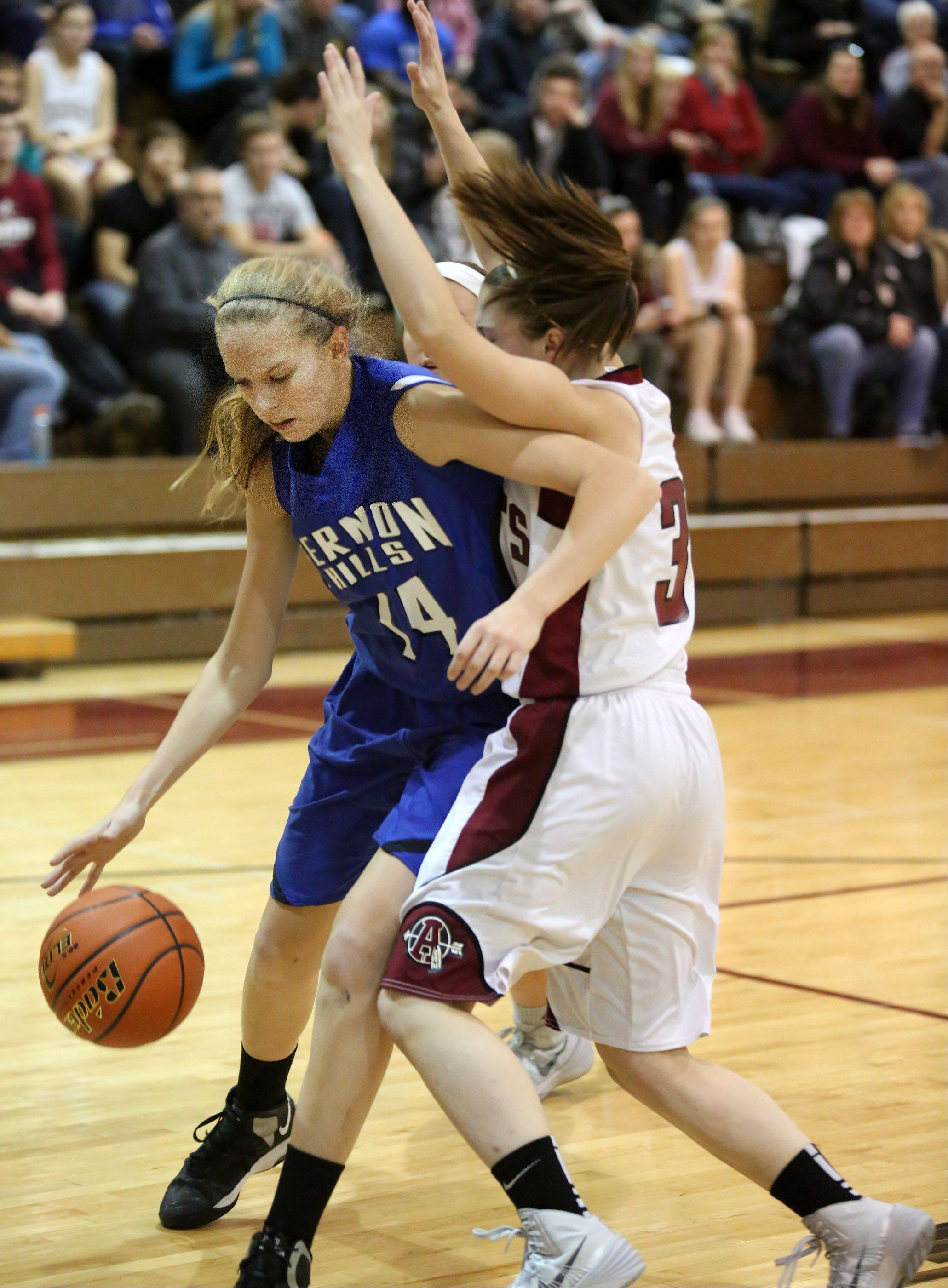 Vernon Hills forward Kasey Firnbach turns the corner under the basket against Antioch guard Shannon Zogran .