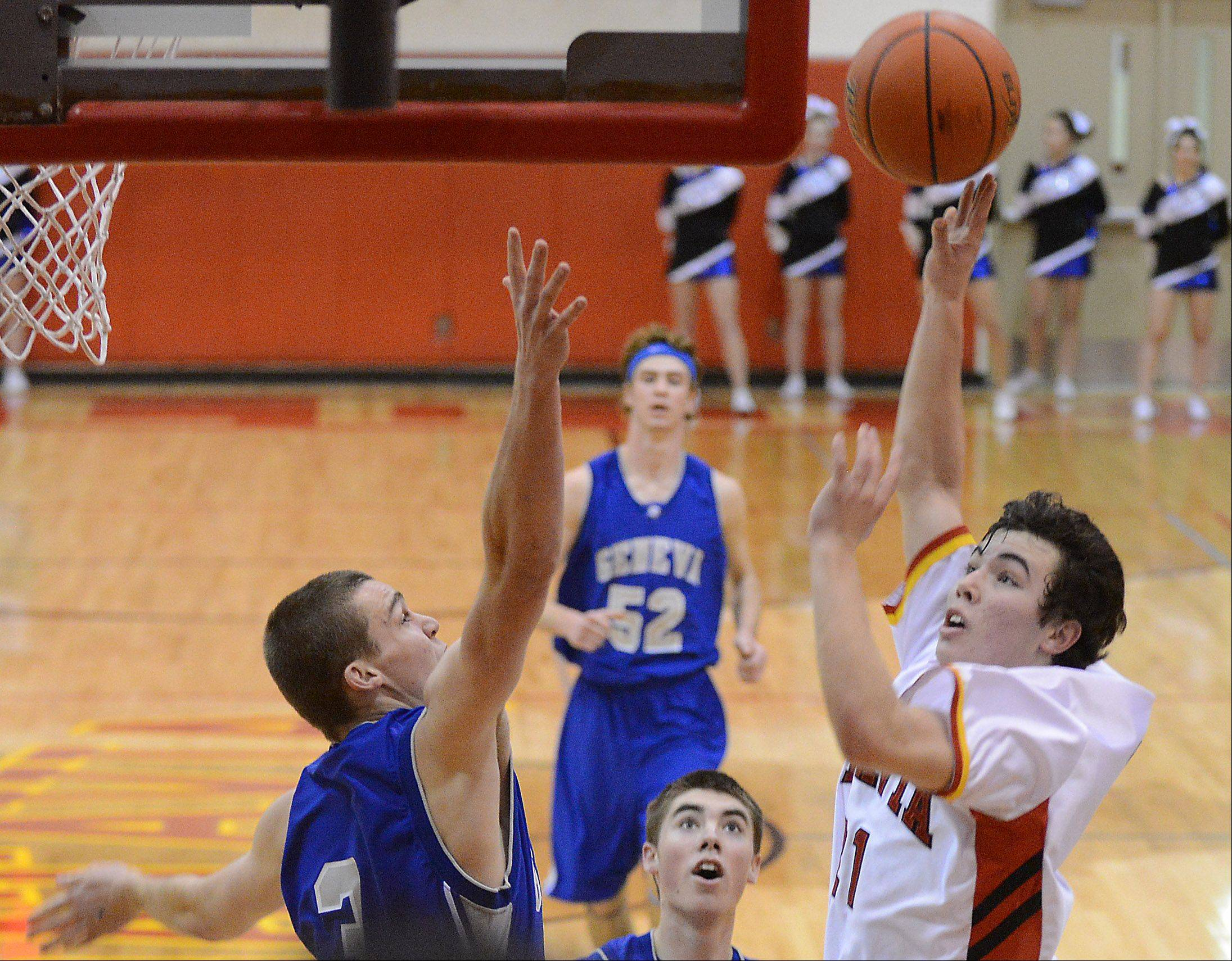 Batavia's Jeremy Schoessling puts up a shot over Geneva's Pace Temple.