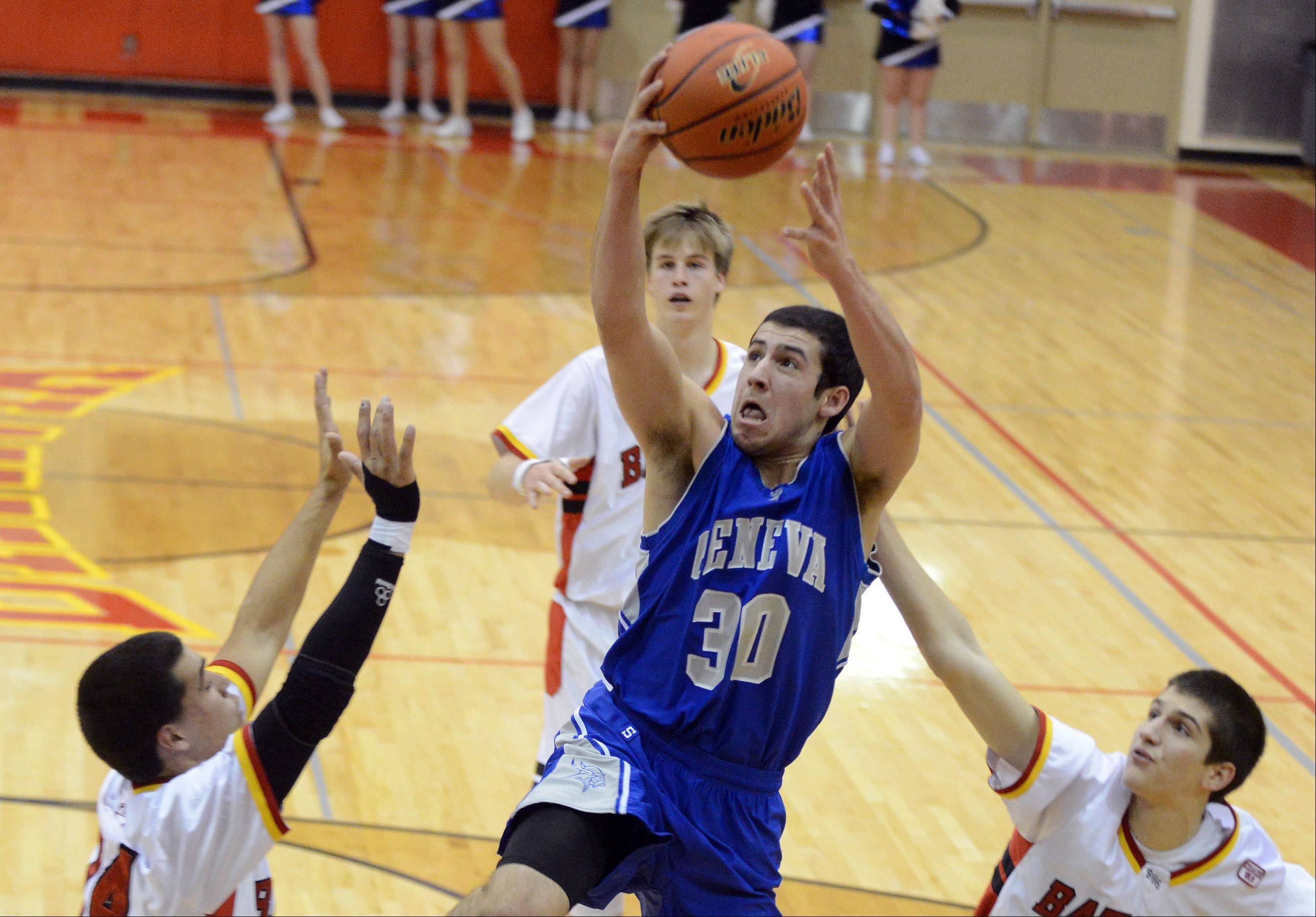 Geneva's Chris Parrilli drives to the basket.