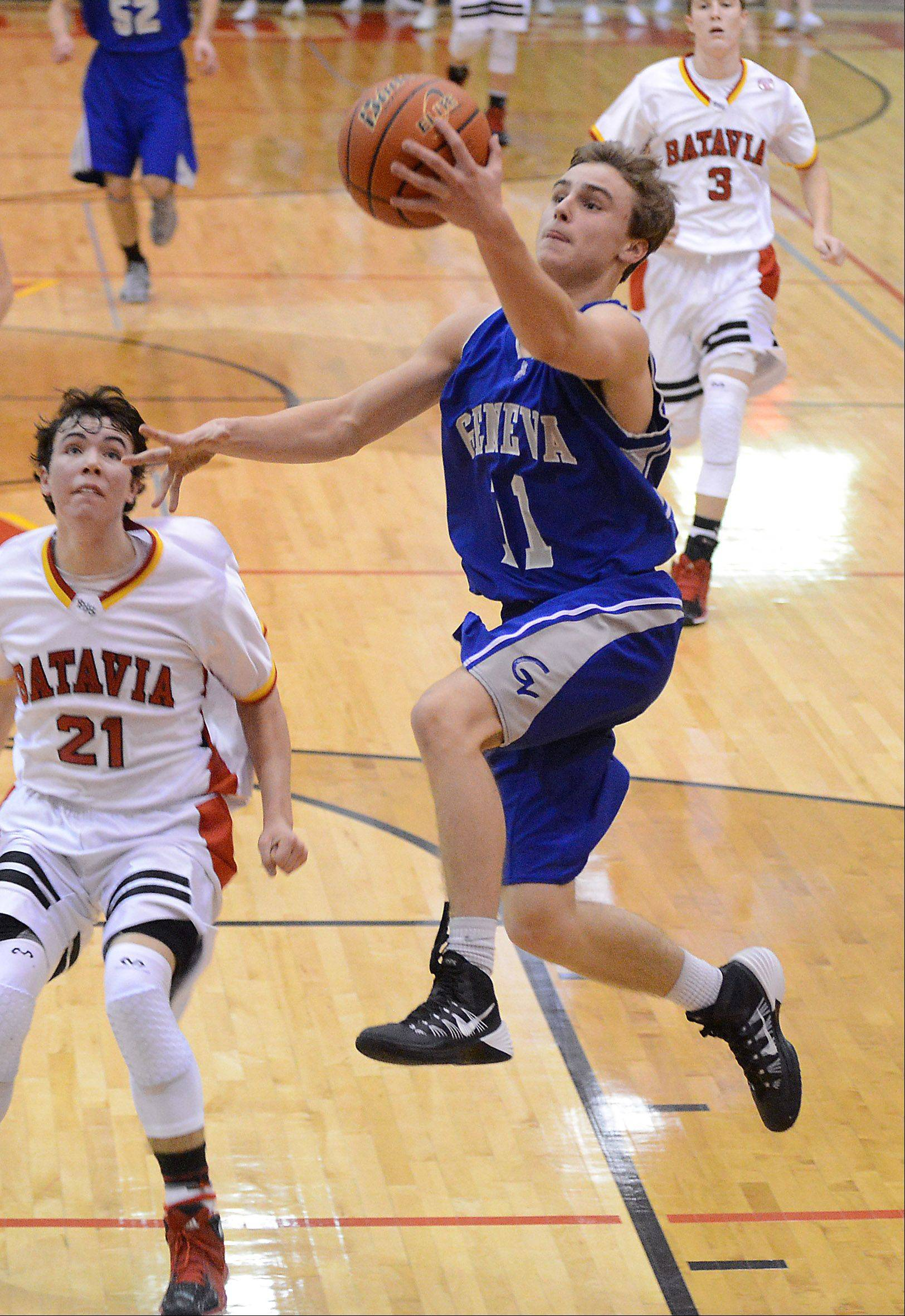 Geneva's Cam Cook drives to the basket past Batavia's Jeremy Schoessling .
